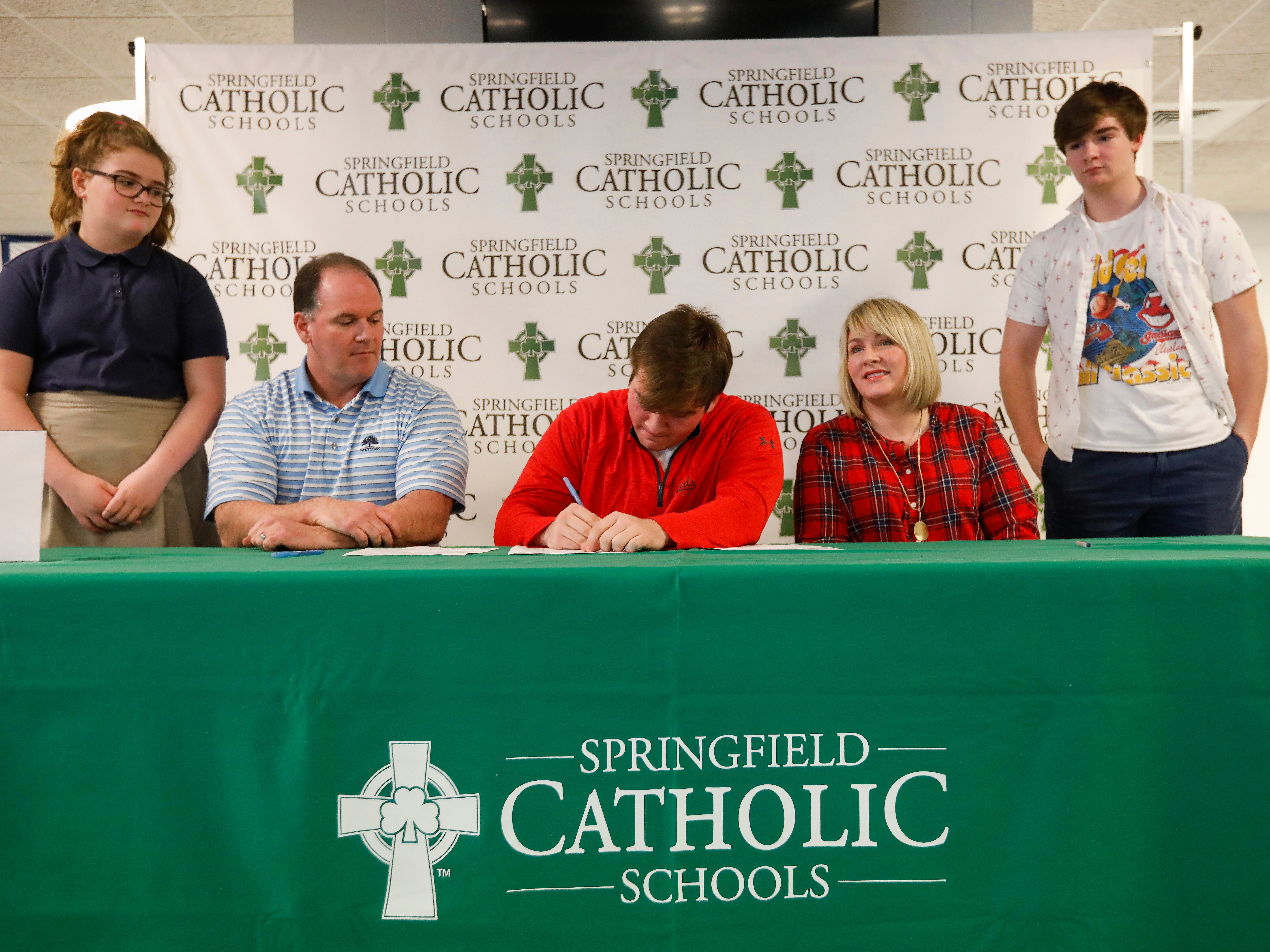 Tyler Welch signed his letter of intent to play football at William Jewell. Also pictured from left are his sister Alexis, dad Terry, mom Nikki and brother Dallas Welch.
