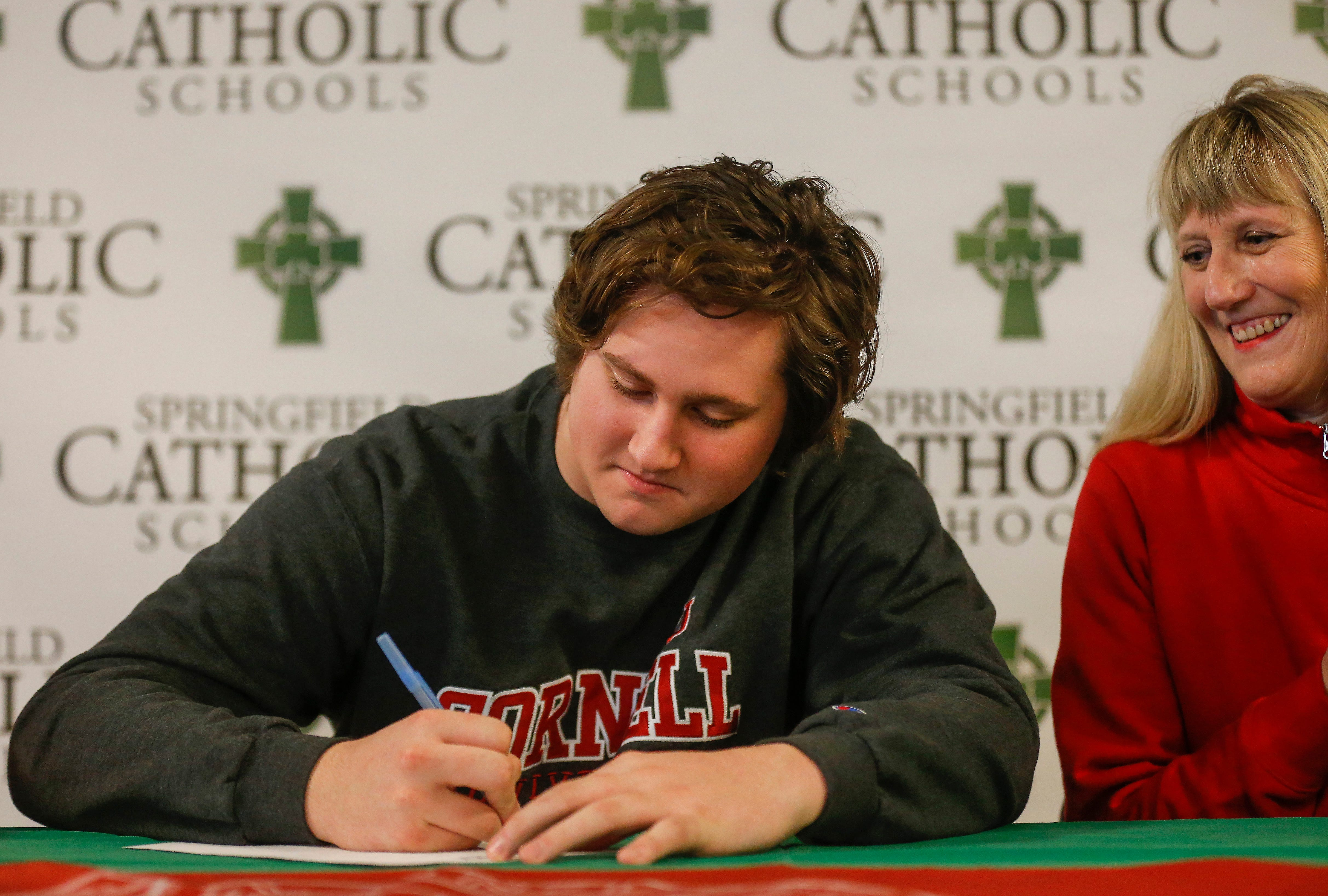 Wallace Squibb signs his letter of intent to play football at Cornell.