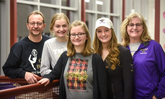 Laken Court poses for a photograph with her father, Tim, sisters Jaden and Riley and mom, Sheila, Friday, Feb. 1, in Cold Spring.