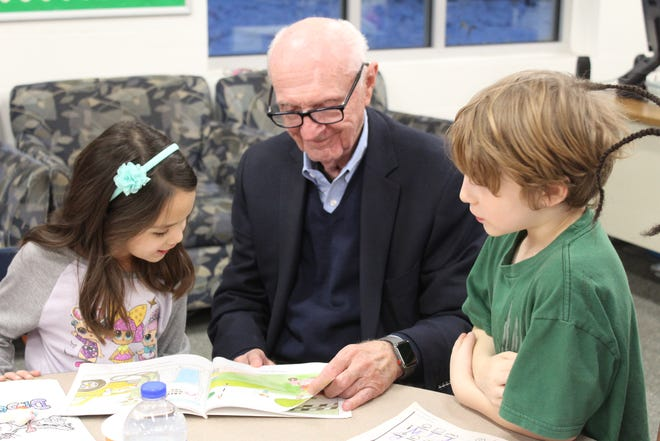 Norman Skalicky of the Norman C. Skalicky Foundation reads to children. He has issued a $5 million gift to launch the Boys & Girls Clubs of Central Minnesota's Great Futures Endowment Campaign.