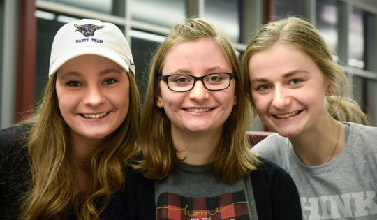 Laken Court, center, poses for a photograph with her sisters Riley, left, and Jaden Friday, Feb. 1, in Cold Spring.