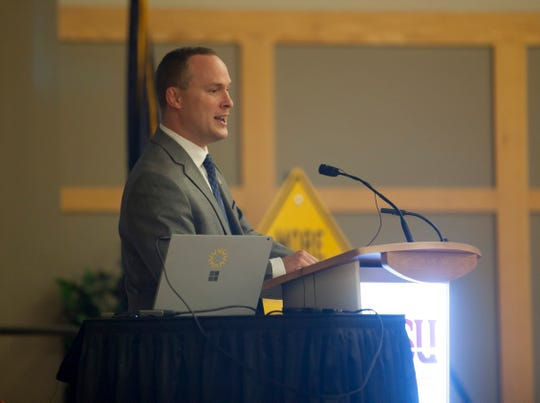 "St. George City Manager Adam Lenhard speaks to a crowd Wednesday at Dixie State University during Mayor Jon Pike's annual ""State of the City"" address."