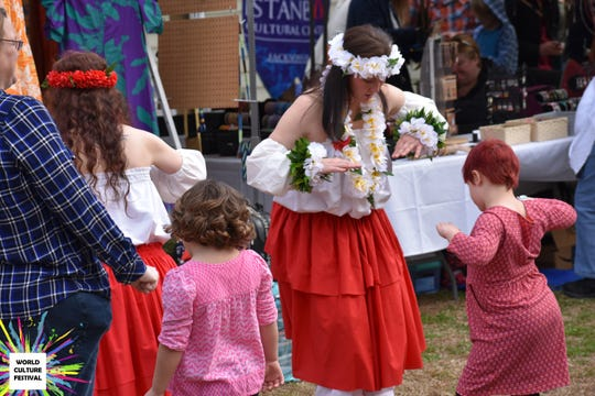 Kids learn about world dances at the festival.