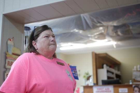Brenda Welch, manager of Yates Pharmacy and Gifts, talks about the damage caused by Hurricane Michael as she stands in the deli portion of the store, Tuesday Feb. 5, 2019. The ceiling of the pharmacy still has tarp covering the openings, four months after Hurricane Michael hit the panhandle.