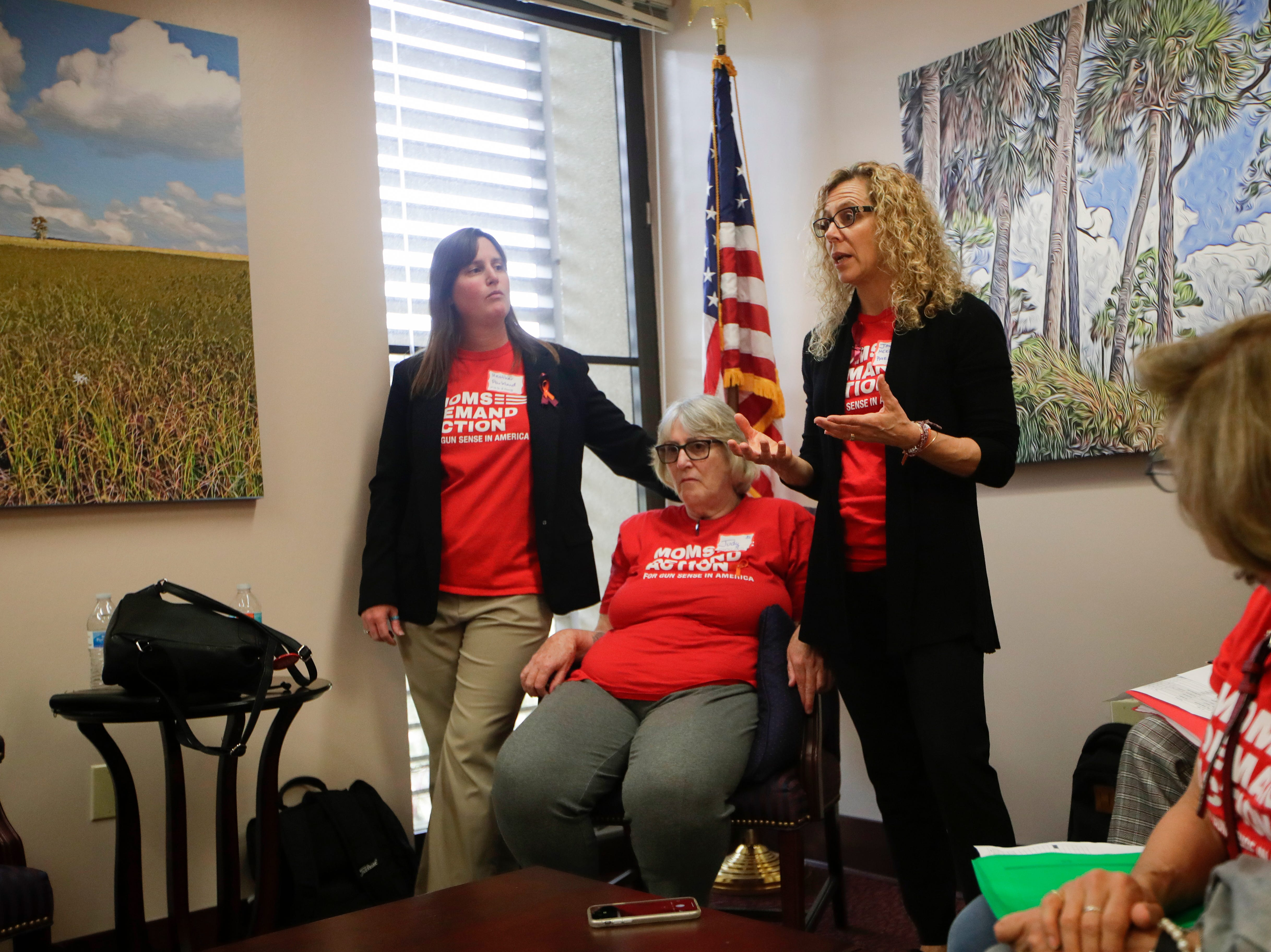 Heather Chapman, left, the mother of two Parkland shooting survivors and her mother Judy Denunzio listen as Janice Herbert-Bates, the mother of another Parkland shooting survivor goes over the bills that Mothers Demand Action would like to see be supported and opposed by Rep. Kirstin Jacobs. Over 500 activists visited the Capitol Wednesday, Feb. 6, 2019 to meet with lawmakers and lobby for stricter gun laws.