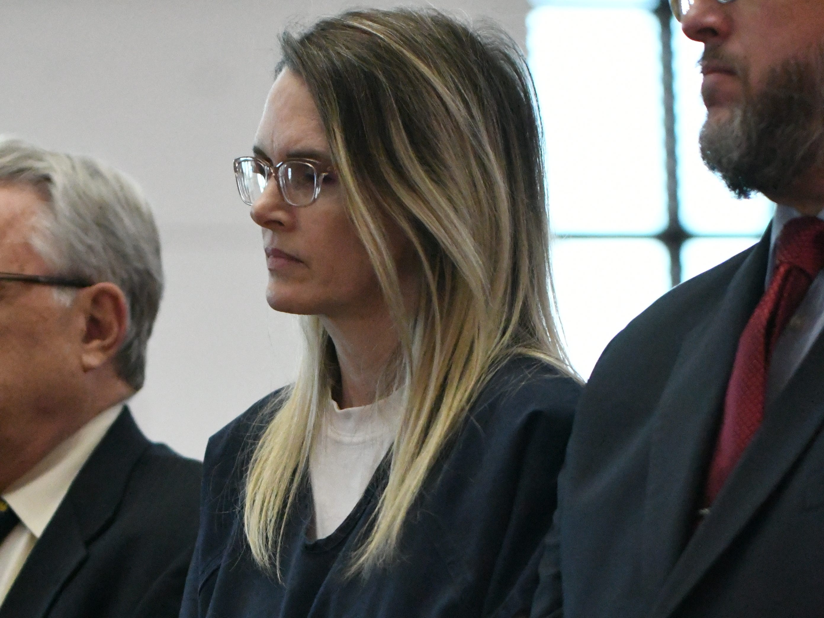Denise Williams stands expressionless and handcuffed in front of Judge James C. Hankinson as he gives Williams her sentencing, Wednesday Feb. 6, 2019, for the murder of her husband Mike Williams. Williams was sentenced to life in prison plus 30 years.