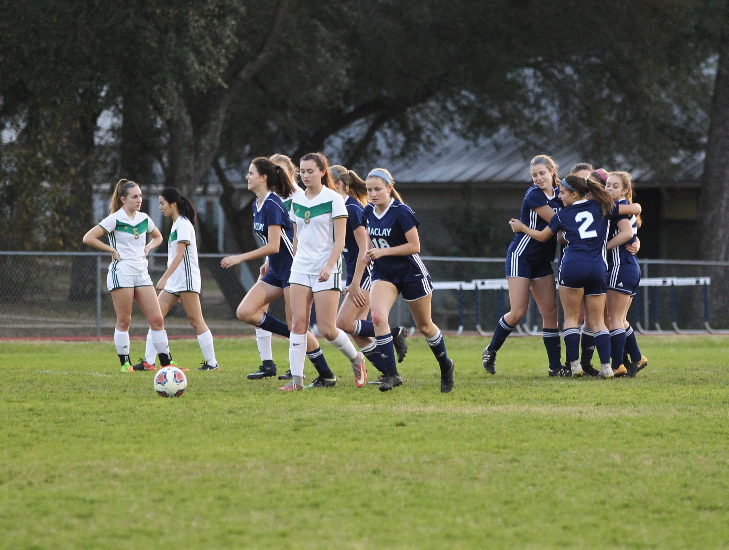 Maclay's Colleen Donahue is mobbed after a PK goal as Maclay's girls soccer team beat St. Joseph Academy 4-0 in a Region 1-1A quarterfinal on Jan. 5, 2019.