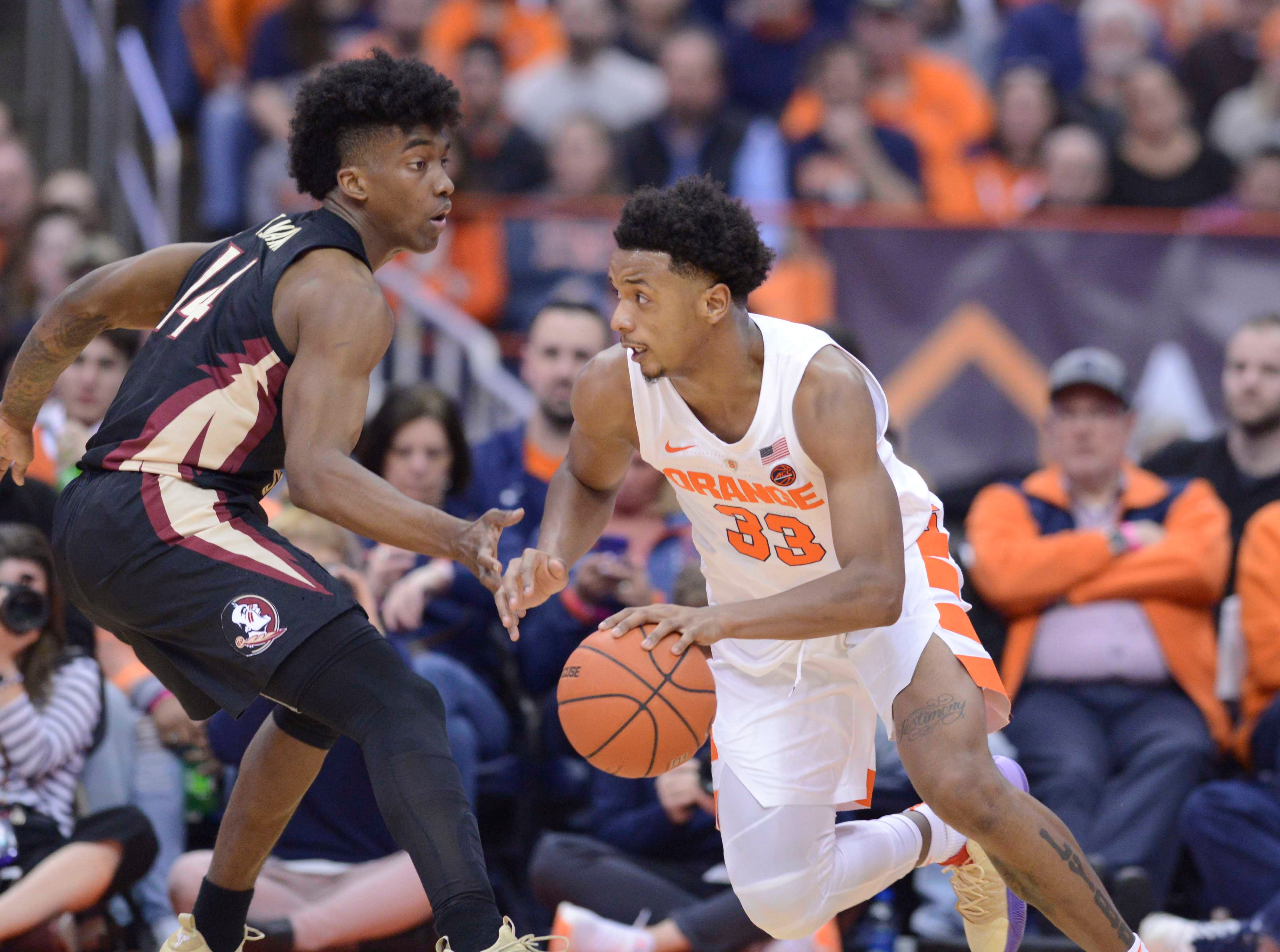 Feb 5, 2019; Syracuse, NY, USA; Syracuse Orange forward Elijah Hughes (33) works to drive the ball past Florida State Seminoles guard Terance Mann (14) in the first half at the Carrier Dome. Mandatory Credit: Mark Konezny-USA TODAY Sports