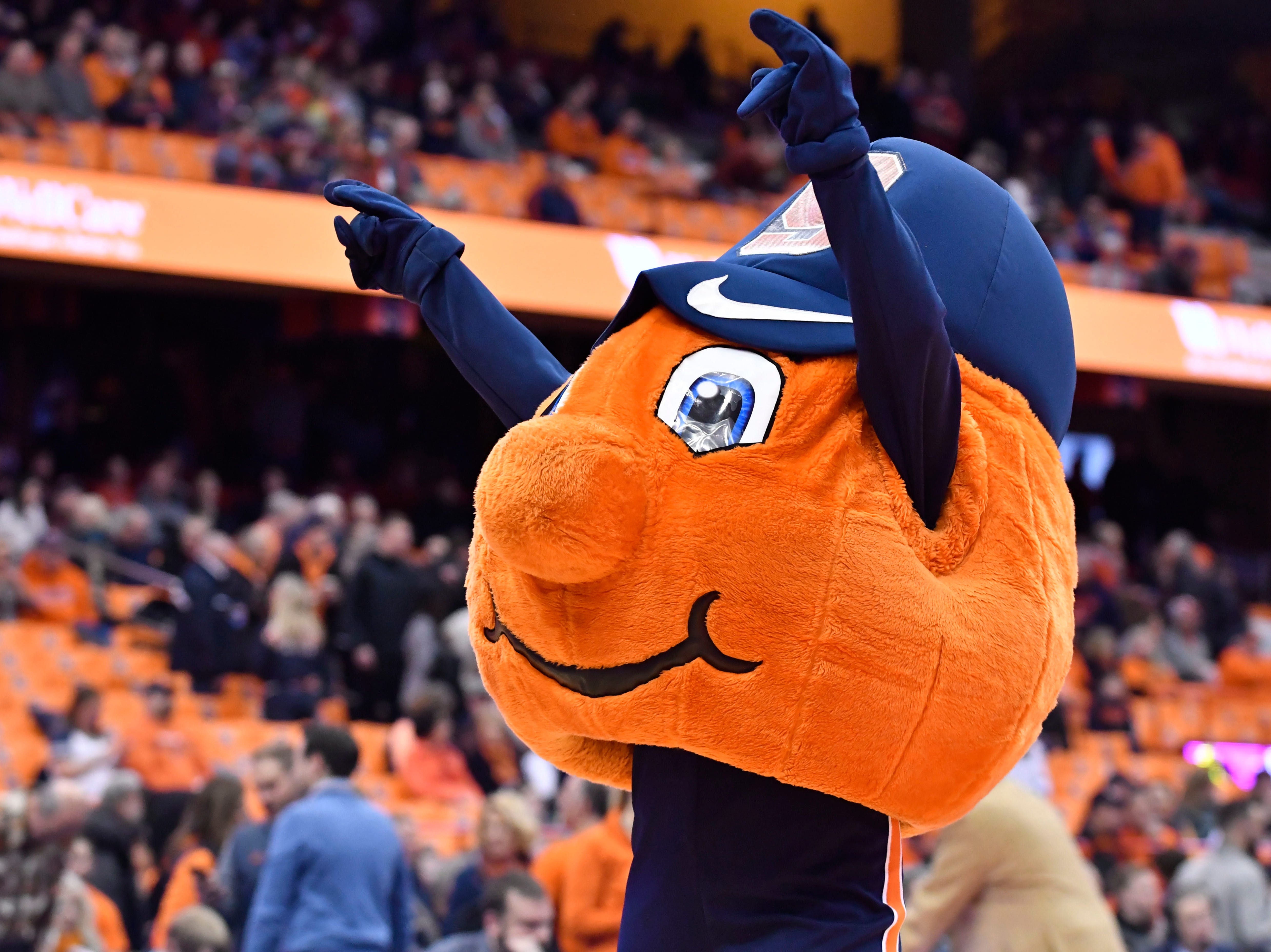 Feb 5, 2019; Syracuse, NY, USA; Otto the Syracuse Orange mascot waves to the crowd prior to the game between the Syracuse Orange and the Florida State Seminoles at the Carrier Dome. Mandatory Credit: Mark Konezny-USA TODAY Sports