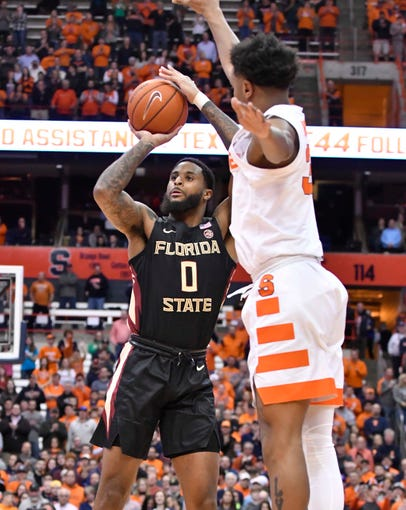 Feb 5, 2019; Syracuse, NY, USA; Florida State Seminoles forward Phil Cofer (0) shoots the ball as Syracuse Orange forward Elijah Hughes (33) defends in the first half at the Carrier Dome. Mandatory Credit: Mark Konezny-USA TODAY Sports