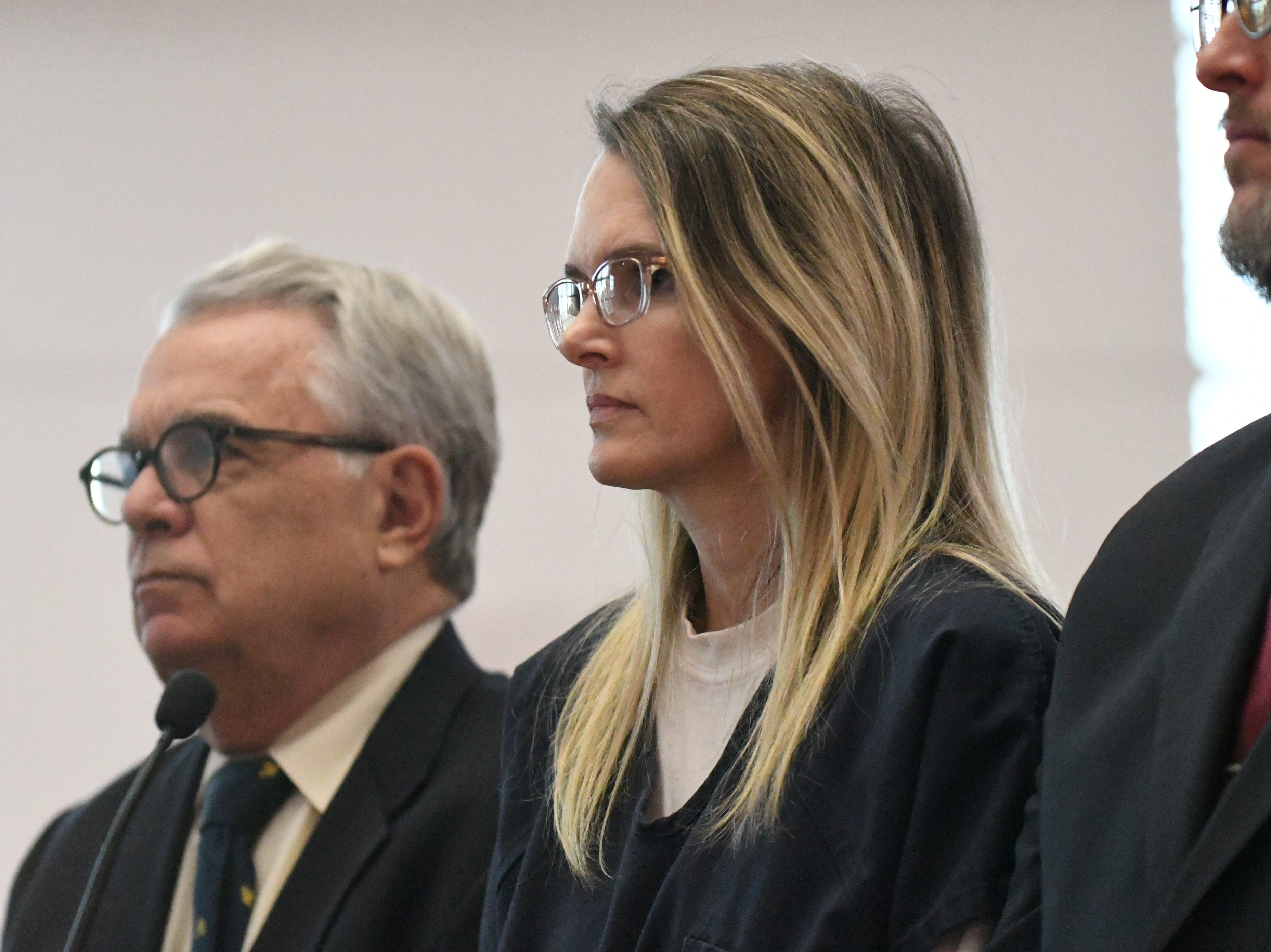Denise Williams stands with her defense attorneys as Judge James C. Hankinson gives Williams her sentencing, Wednesday Feb. 6, 2019, for the murder of her husband Mike Williams. Williams was sentenced to life in prison plus 30 years.