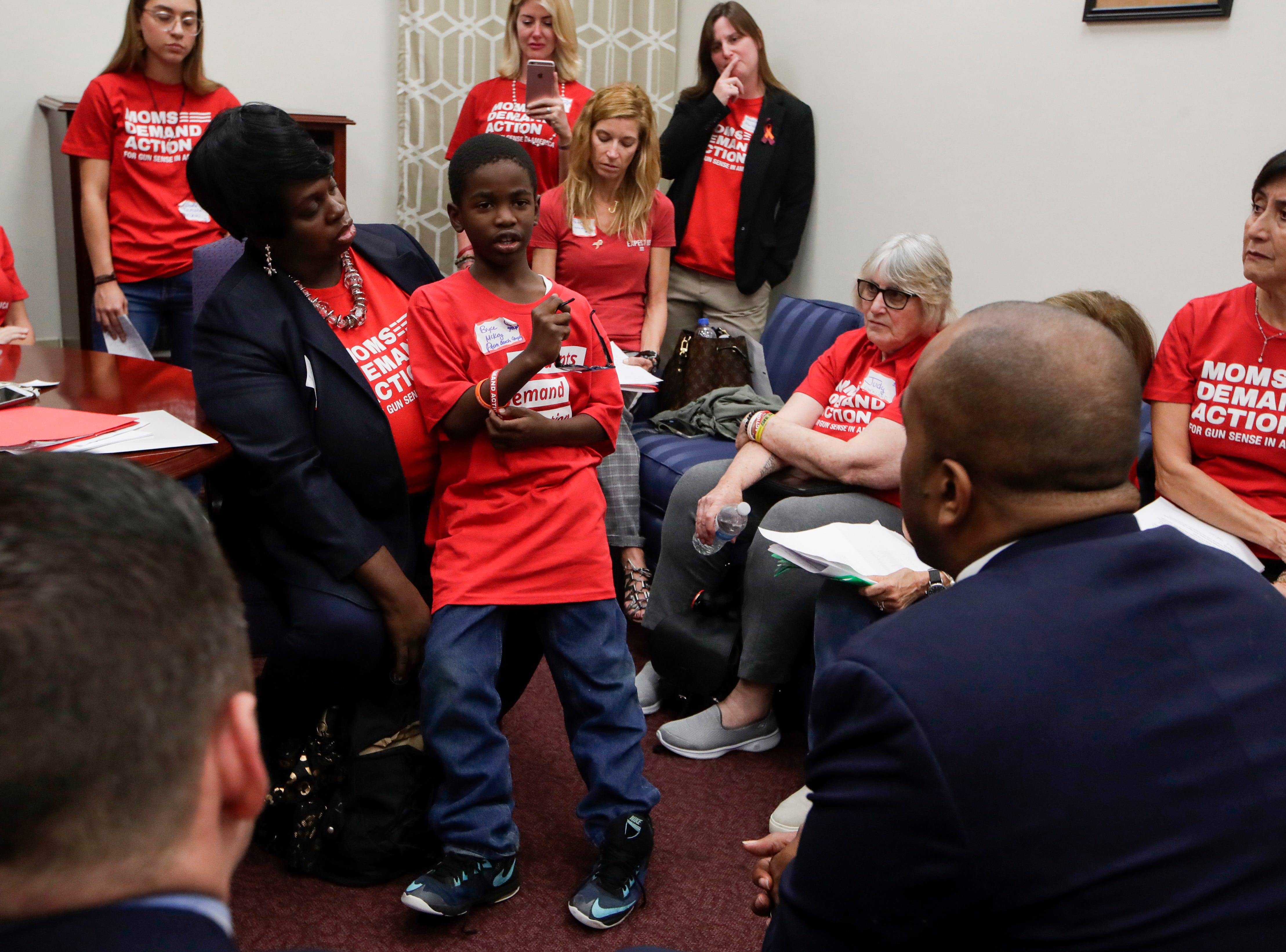 Bryce Mckoy, 9, a second grader from Palm Beach County, shyly tells Sen. Bobby Powell about his fears about going to school he developed after the shooting at Marjory Stoneman Douglas almost a year ago. Mckoy and his mother Teisha Mckoy visited the Capitol along with over 500 other activists from Moms Demand Action to lobby for stricter gun laws. The pair also recently visited Washington, D.C. to lobby there.