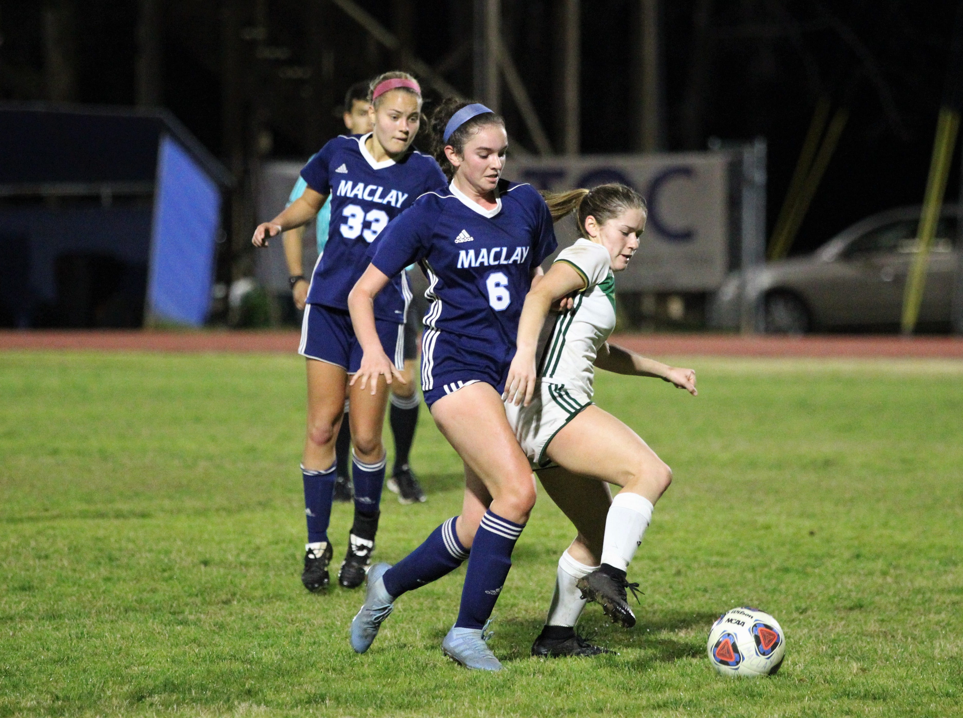 Maclay's Laura Kathryn Foote tries to keep her opponent from turning upfield as Maclay's girls soccer team beat St. Joseph Academy 4-0 in a Region 1-1A quarterfinal on Jan. 5, 2019.