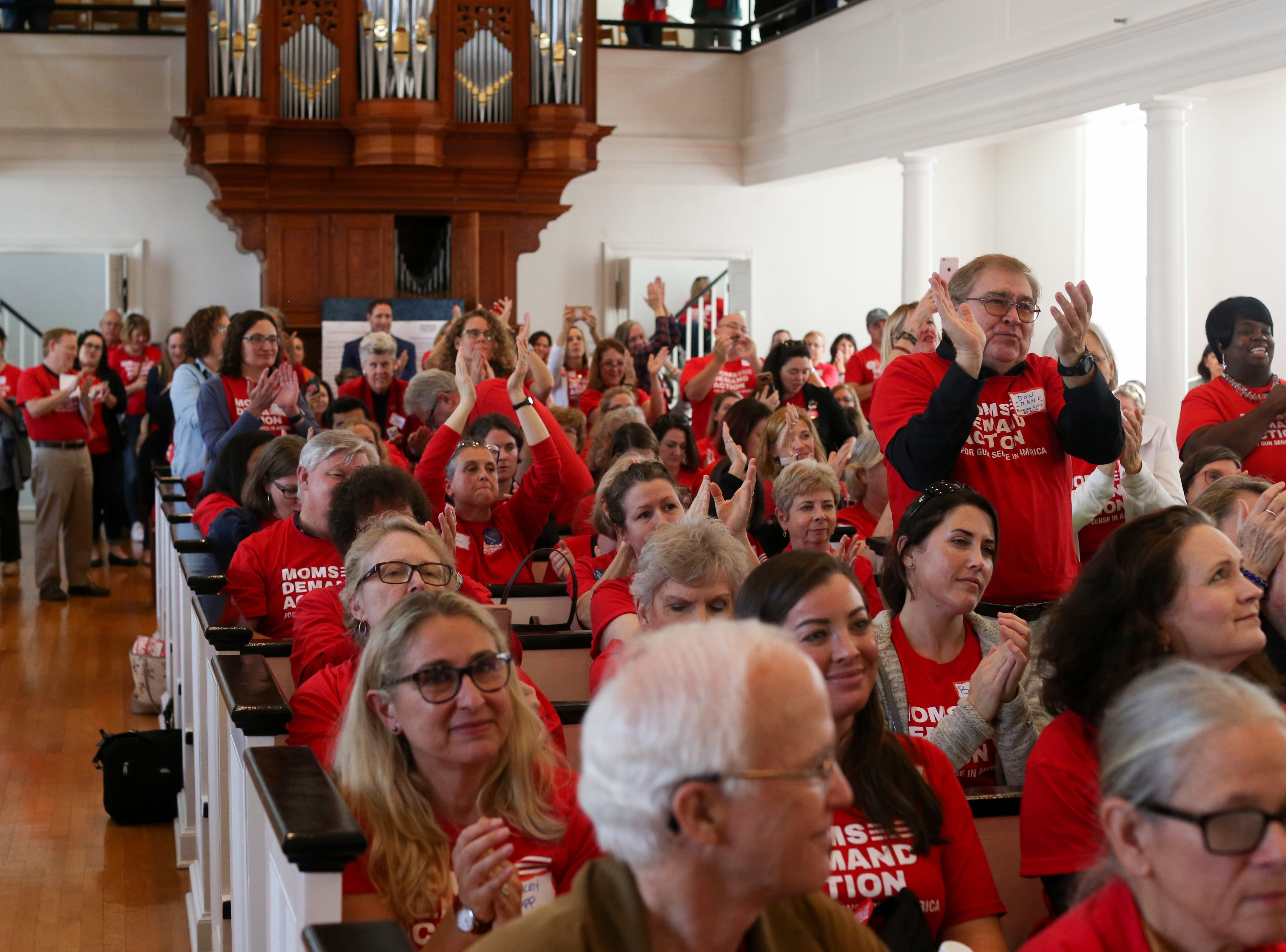 """The crowd gives a standing ovation for Agriculture Commissioner Nikki Fried as she addresses over 500 activists from Moms Demand Action gathered at First Presbyterian Church in Tallahassee. """"The NRA is no longer in charge of the Department of Agriculture,"""" Fried said."""