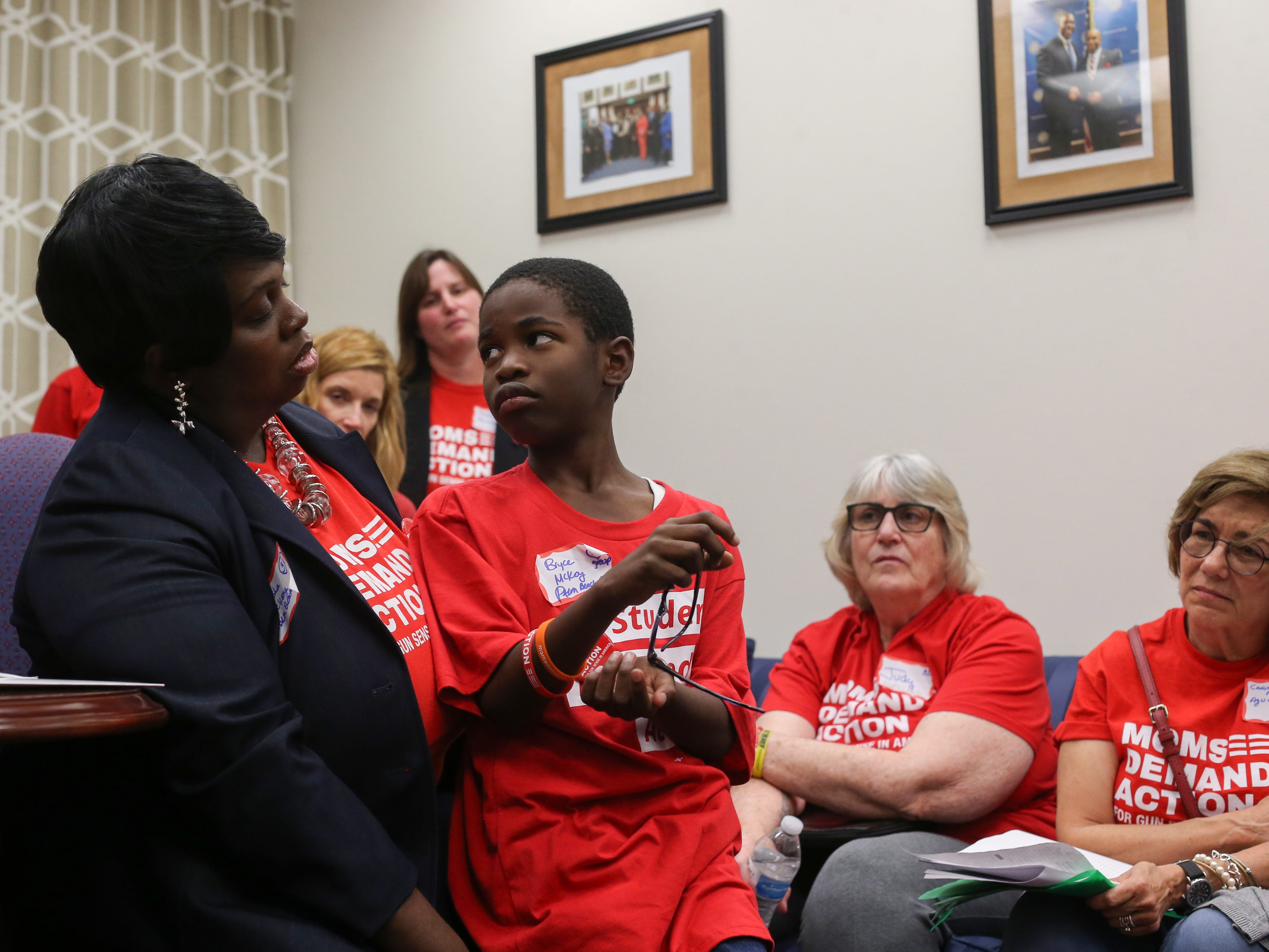 Bryce Mckoy, a 9-year-old second grader from Palm Beach County, looks at his mom, Teisha Mckoy, as she encourages him to share the fears he has about going to school after the Marjory Stoneman Douglas shooting with Sen. Bobby Powell in Powell's office Wednesday, Feb. 6, 2019. Teisha Mckoy joined Moms Demand Action after the shooting almost a year ago which brought her to the Capitol with her son and over 500 other members to lobby for stricter gun laws.