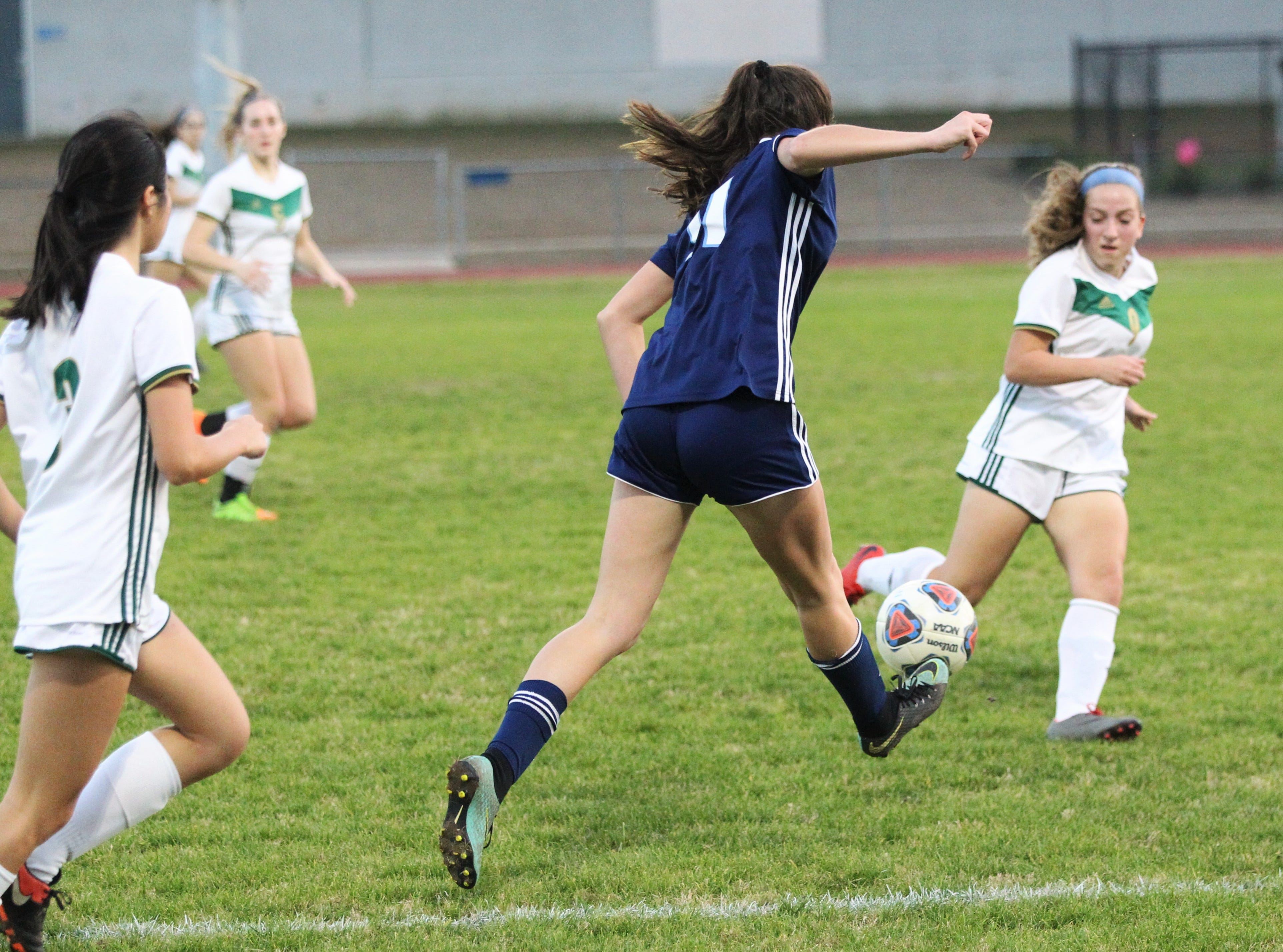 Maclay's Madison Perkins drills a cross as Maclay's girls soccer team beat St. Joseph Academy 4-0 in a Region 1-1A quarterfinal on Jan. 5, 2019.