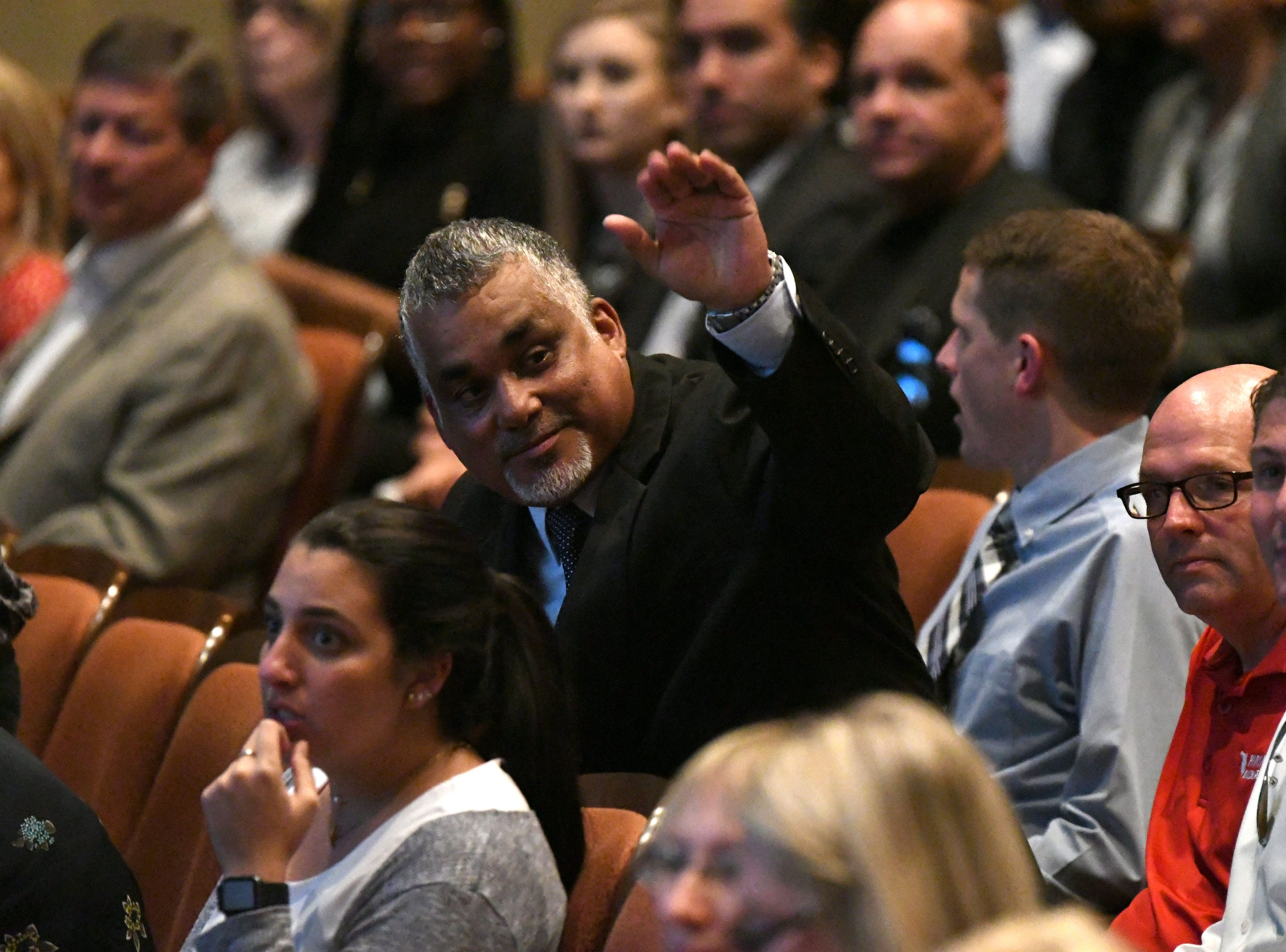 A gentleman waves to a friend in the crowd of the Power Forward business event held in the Ruby Diamond Hall, Wednesday Feb. 6, 2019. Shark Tank co-star and serial entrepreneur Kevin O'Leary was the featured speaker at the event.