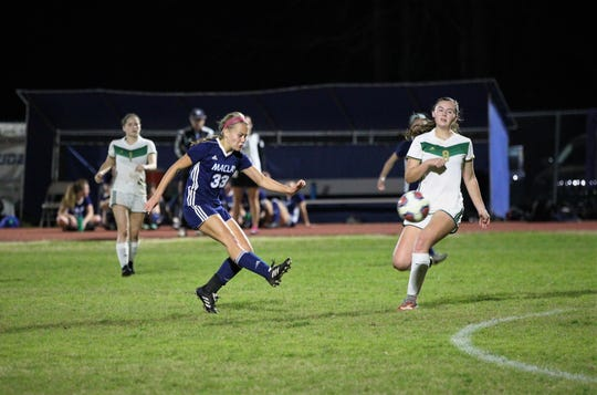 Maclay's Colleen Donahue takes a shot from distance as Maclay's girls soccer team beat St. Joseph Academy 4-0 in a Region 1-1A quarterfinal on Jan. 5, 2019.