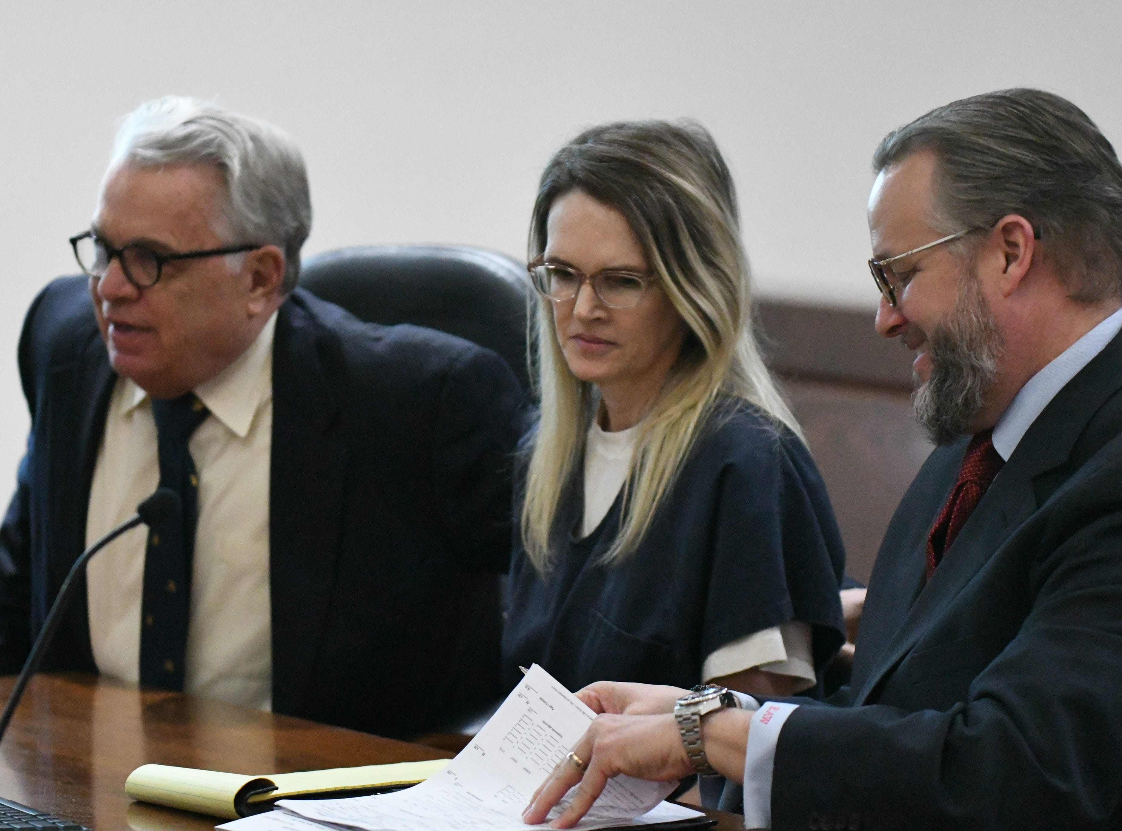 Defense attorney Phil Padovano, left, Denise Williams, and defense attorney Ethan Way go over notes before Williams' sentencing, Wednesday Feb. 6, 2019, for the murder of her husband Mike Williams. Williams was sentenced to life in prison plus thirty years.