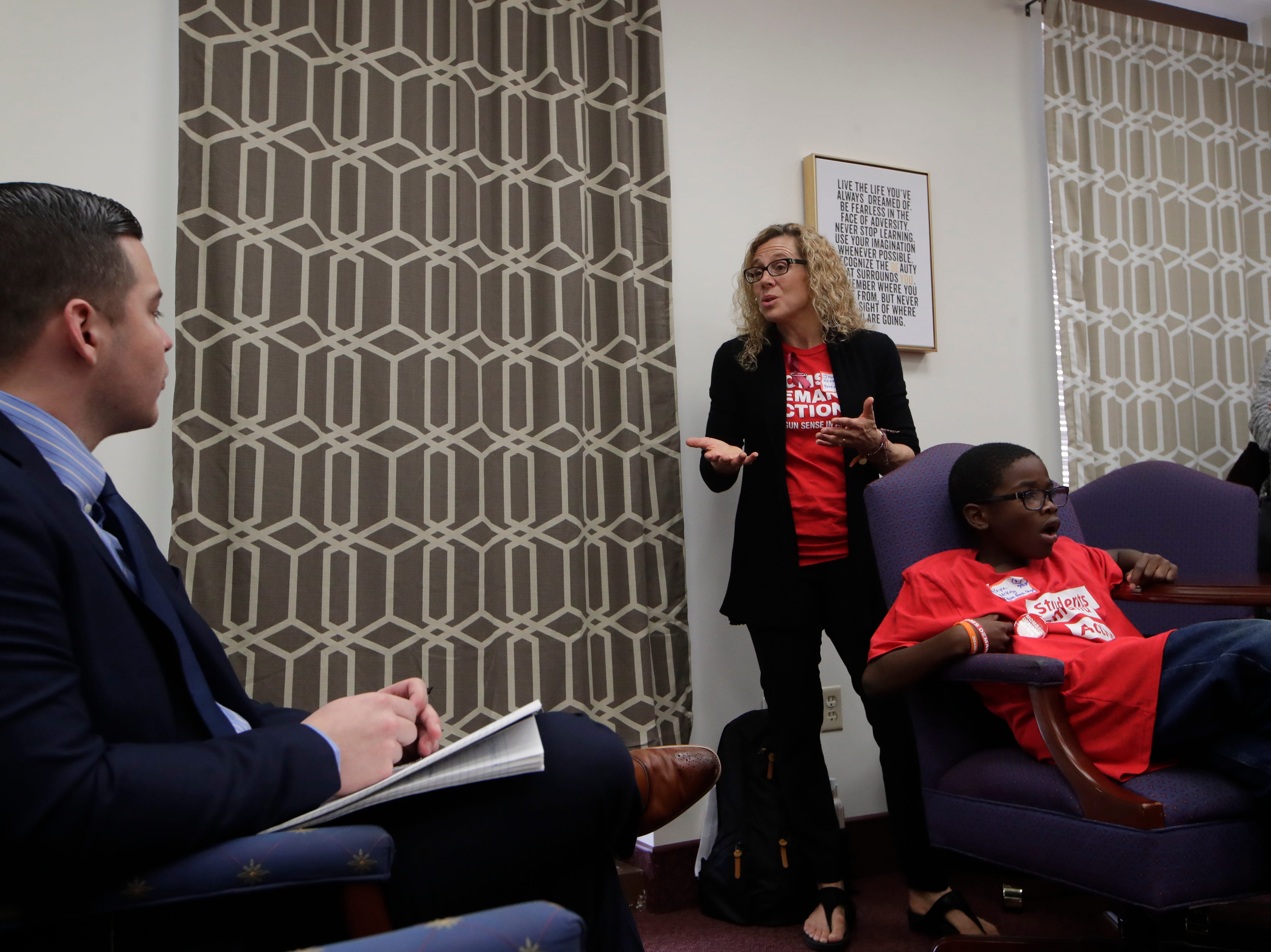 Janice Herbert-Bates, the mother of a Parkland shooting survivor, speaks to Tomas Alcala, a legislative assistant to Sen. Bobby Powell in Powell's office Wednesday, Feb. 6, 2019. Herbert-Bates and over 500 activists from Moms Demand Action visited the Capitol to meet with lawmakers to lobby for stricter gun laws.