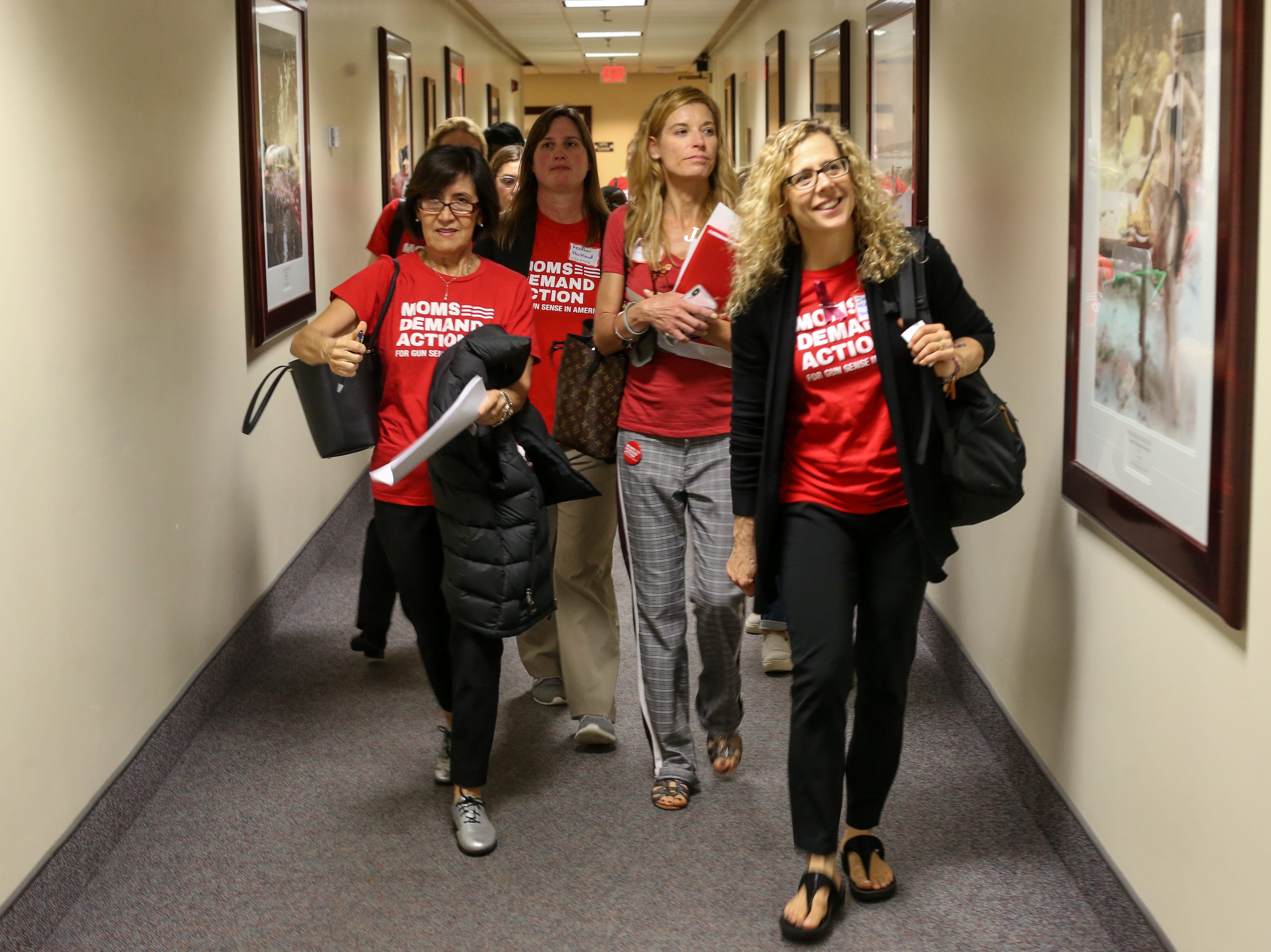 Members of Moms Demand Action from Broward and Palm Beach counties walk through the Capitol looking for the office of Sen. Bobby Powell as they meet with lawmakers to lobby for stricter gun laws Wednesday, Feb. 6, 2019.