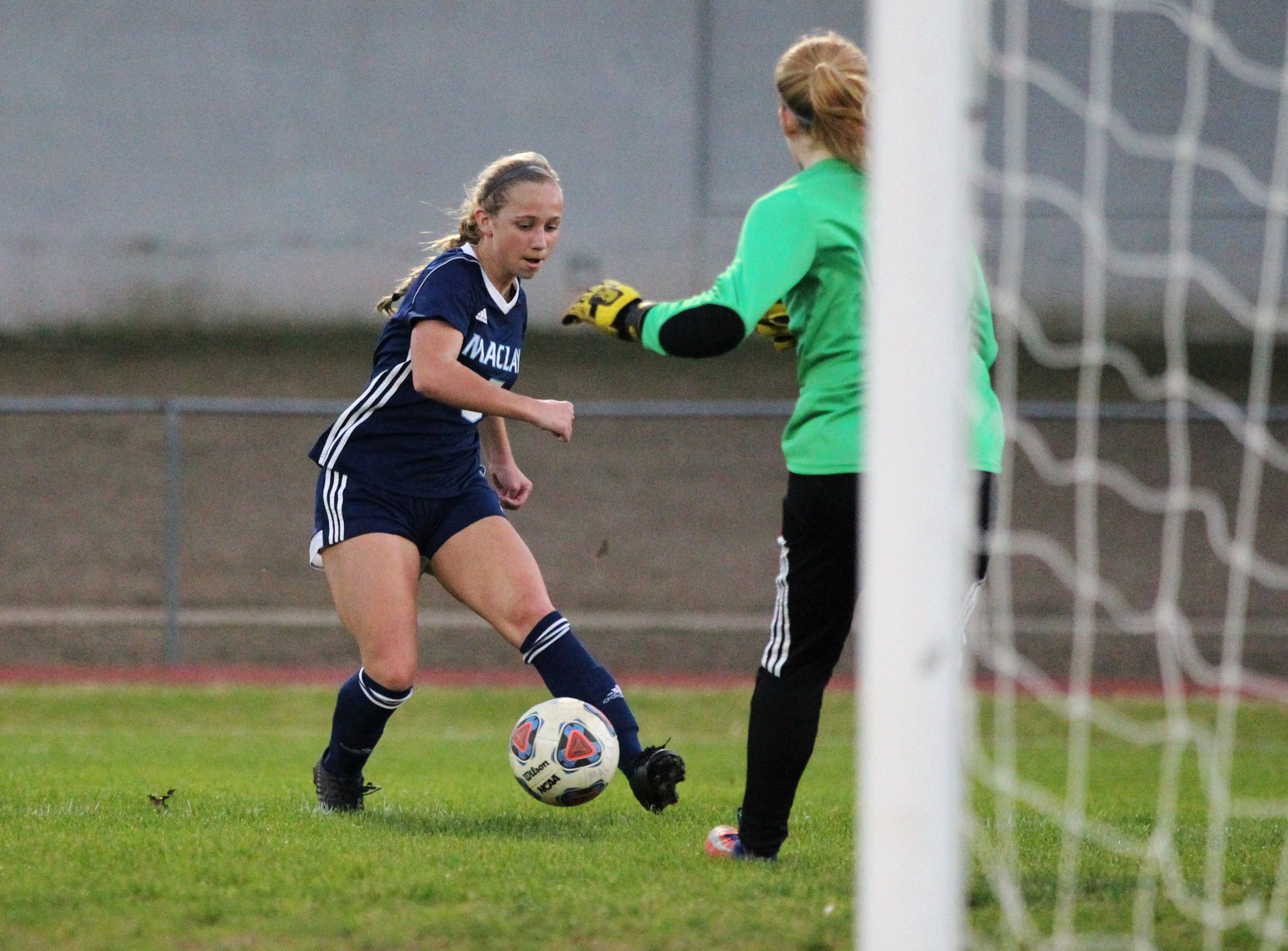 Maclay's Katelyn Dessi sends a pass across the face of goal as Maclay's girls soccer team beat St. Joseph Academy 4-0 in a Region 1-1A quarterfinal on Jan. 5, 2019.