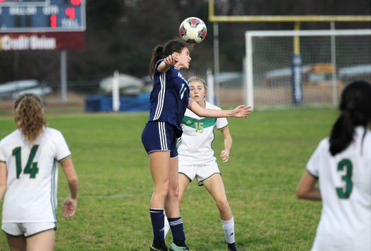 Maclay's Madison Perkins goes up for a header as Maclay's girls soccer team beat St. Joseph Academy 4-0 in a Region 1-1A quarterfinal on Jan. 5, 2019.