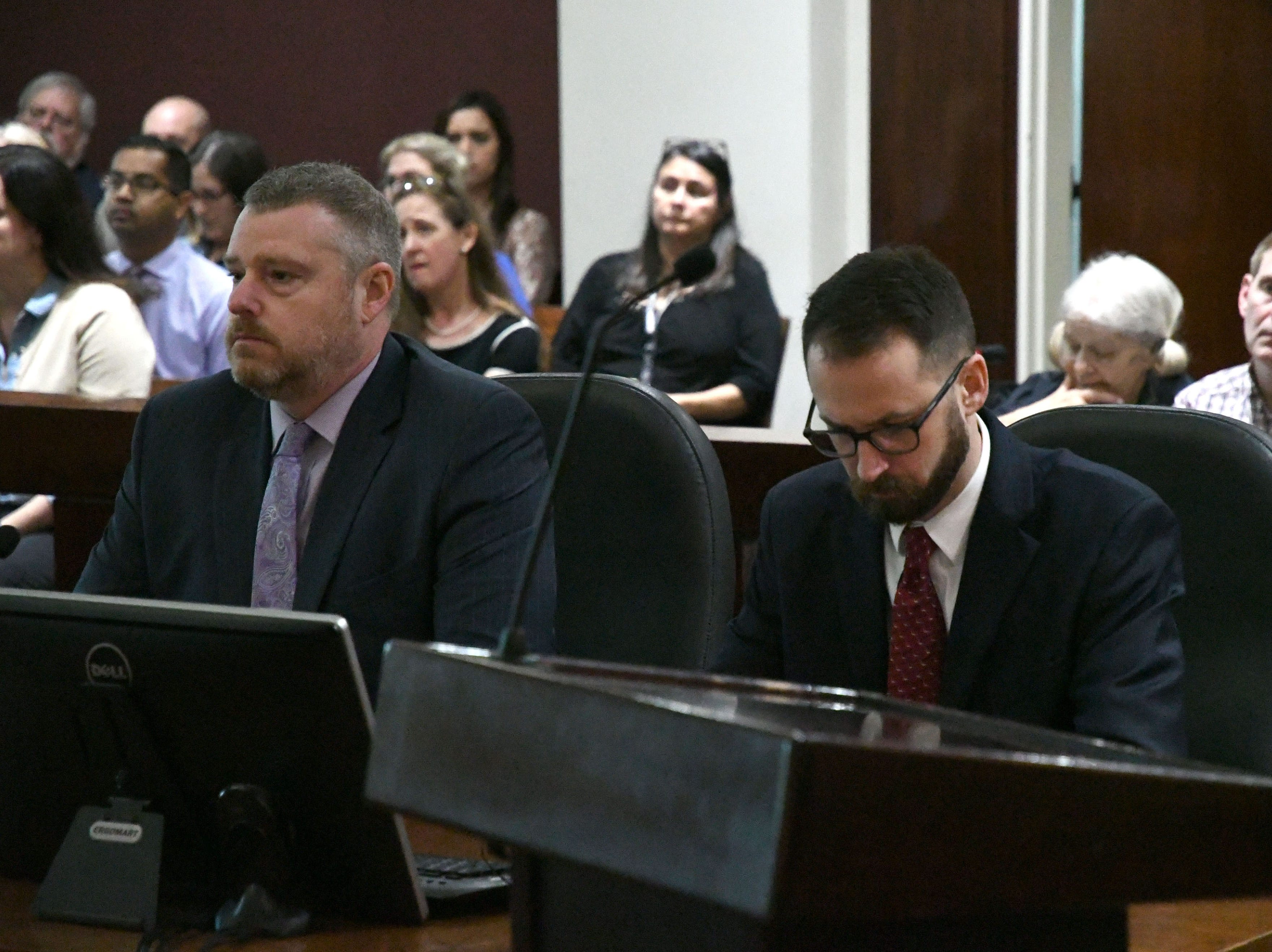 Assistant state attorney Jon Fuchs, left, and assistant state attorney Andy Rogers await the arrival of Judge James C. Hankinson and the sentencing of Denise Williams for the murder of her husband Mike Williams. Williams was sentenced to life in prison plus thirty years, Wednesday Feb. 6, 2019.
