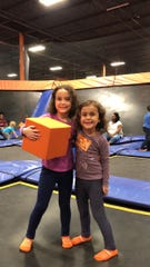 Apollonia and Vivian Acevedo take a quick breather before jumping back into the fun at SkyZone.