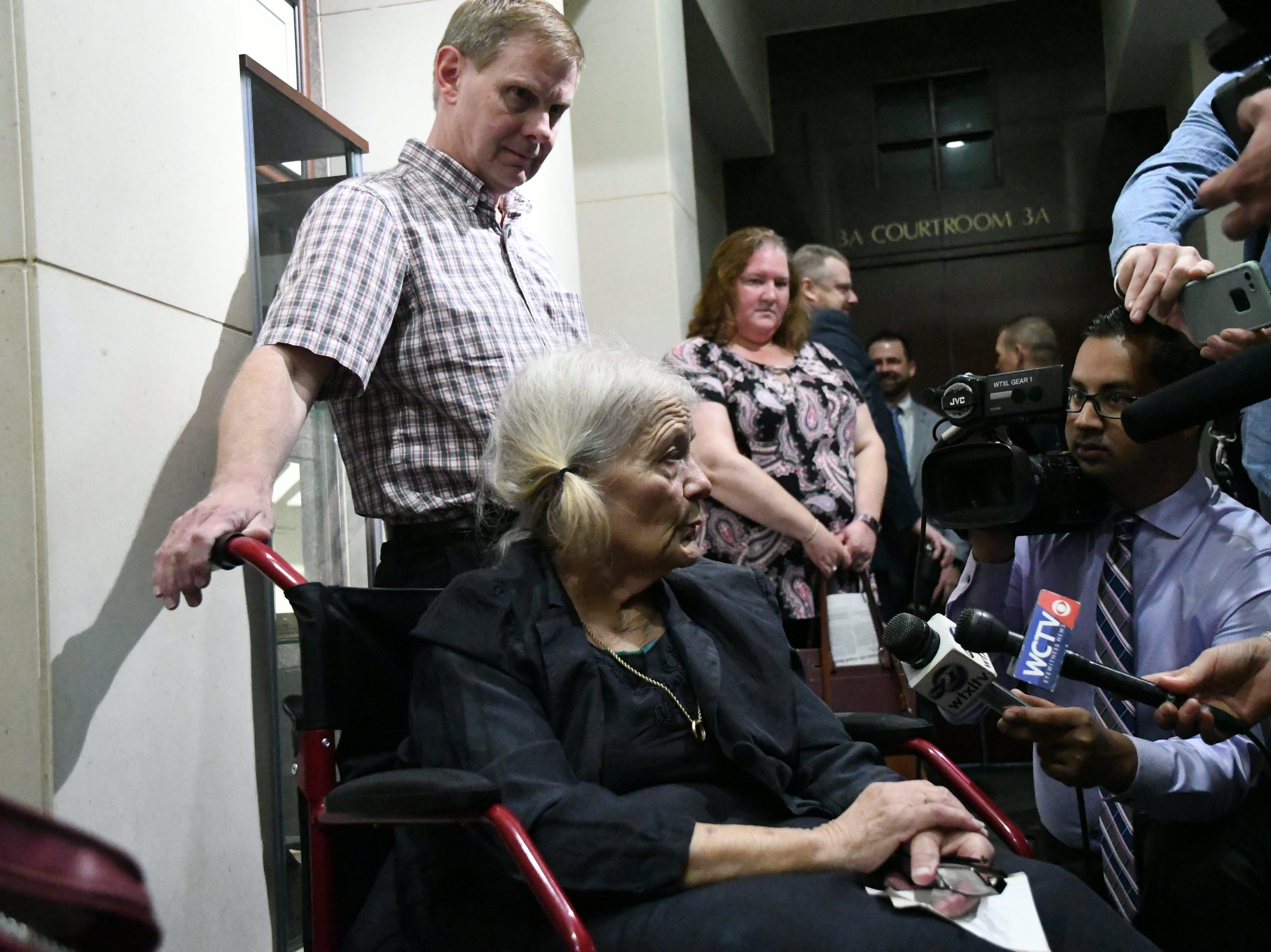 Nick Williams, brother of Mike Williams, the man who was murdered 18 years ago, stands by his mother Cheryl Williams' side as she speaks to the press after the sentencing of Denise Williams for the murder of her husband Mike Williams. Denise was sentenced to life in prison plus 30 years, Wednesday Feb. 6, 2019.