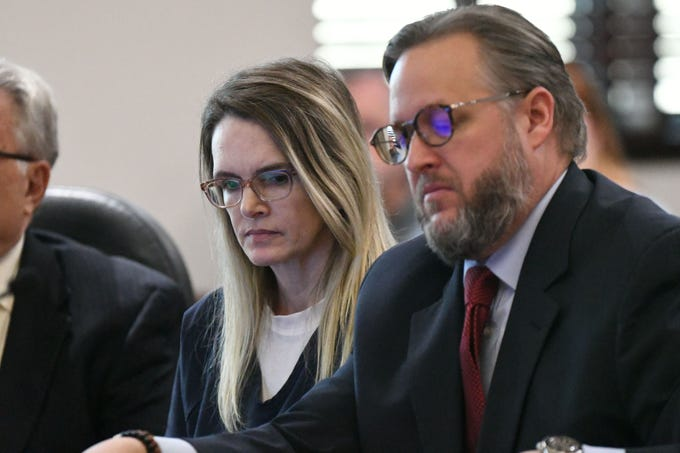 Denise Williams, the woman who was found guilty for the murder of her husband Mike Williams, sits expressionlessly with her defense team during her sentencing, Wednesday Feb. 6, 2019. Williams was sentenced to life in prison plus 30 years.