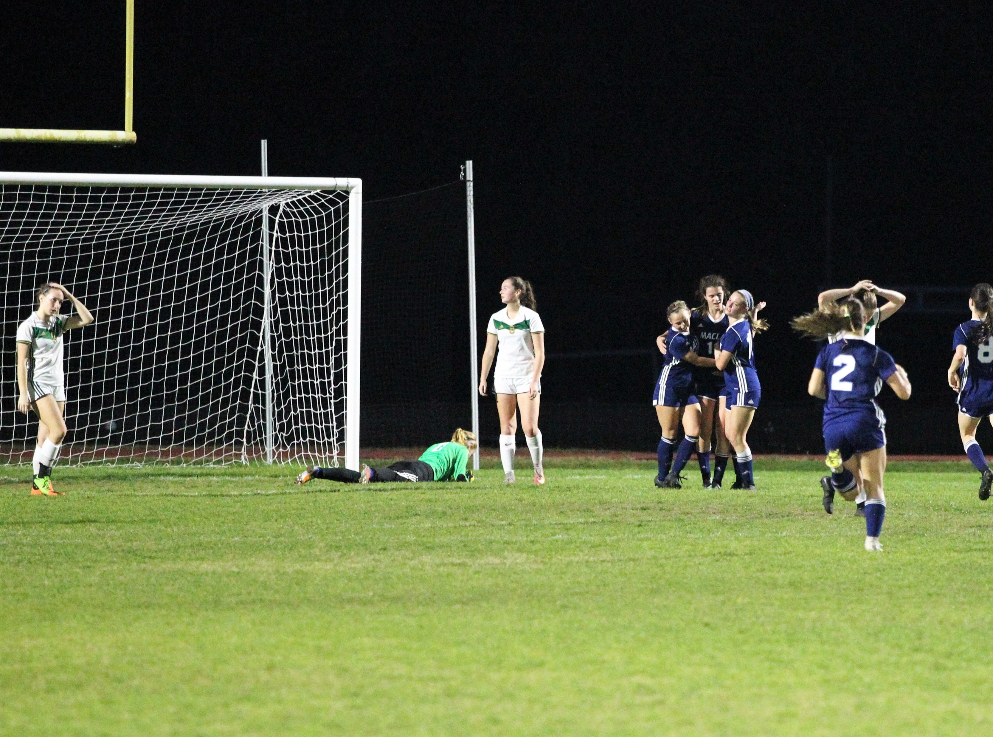 Maclay's Madison Perkins is mobbed after a rebound goal as Maclay's girls soccer team beat St. Joseph Academy 4-0 in a Region 1-1A quarterfinal on Jan. 5, 2019.