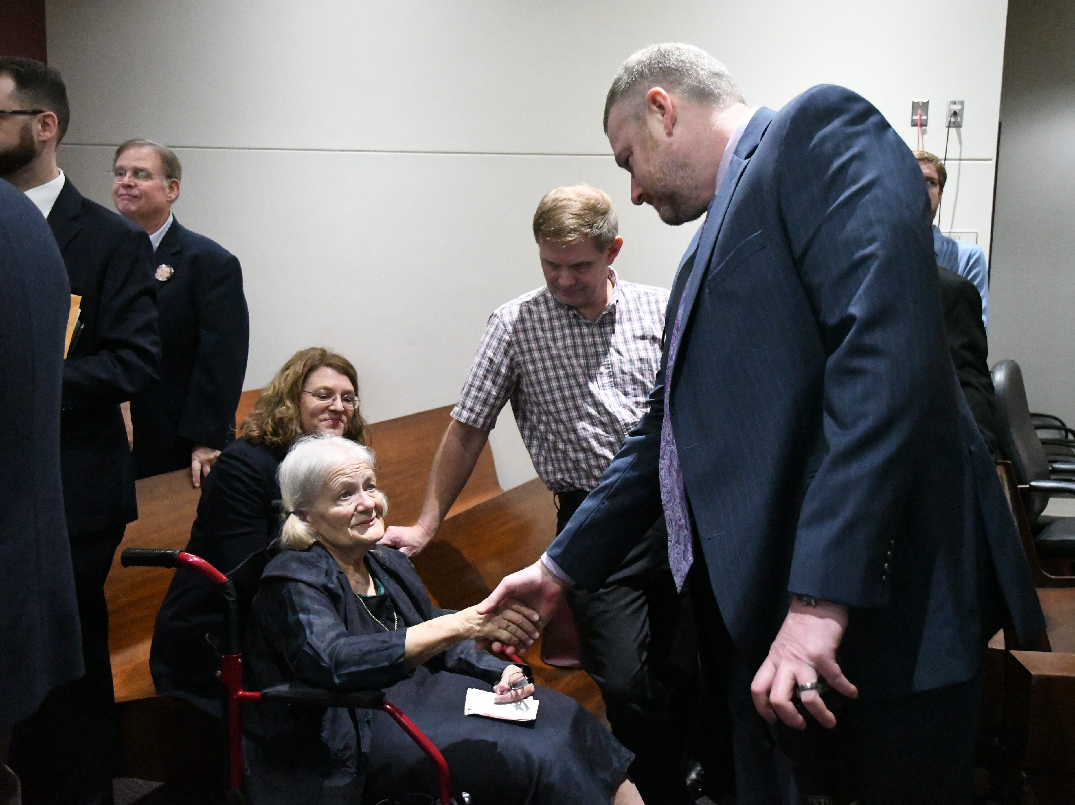 Cheryl Williams, mother of Mike Williams, the man who was murdered 18 years ago, shakes hands with assistant state attorney Jon Fuchs after listening to Denise Williams be sentenced to life in prison plus 30 years for murdering her husband Mike Williams, Wednesday Feb. 6, 2019.