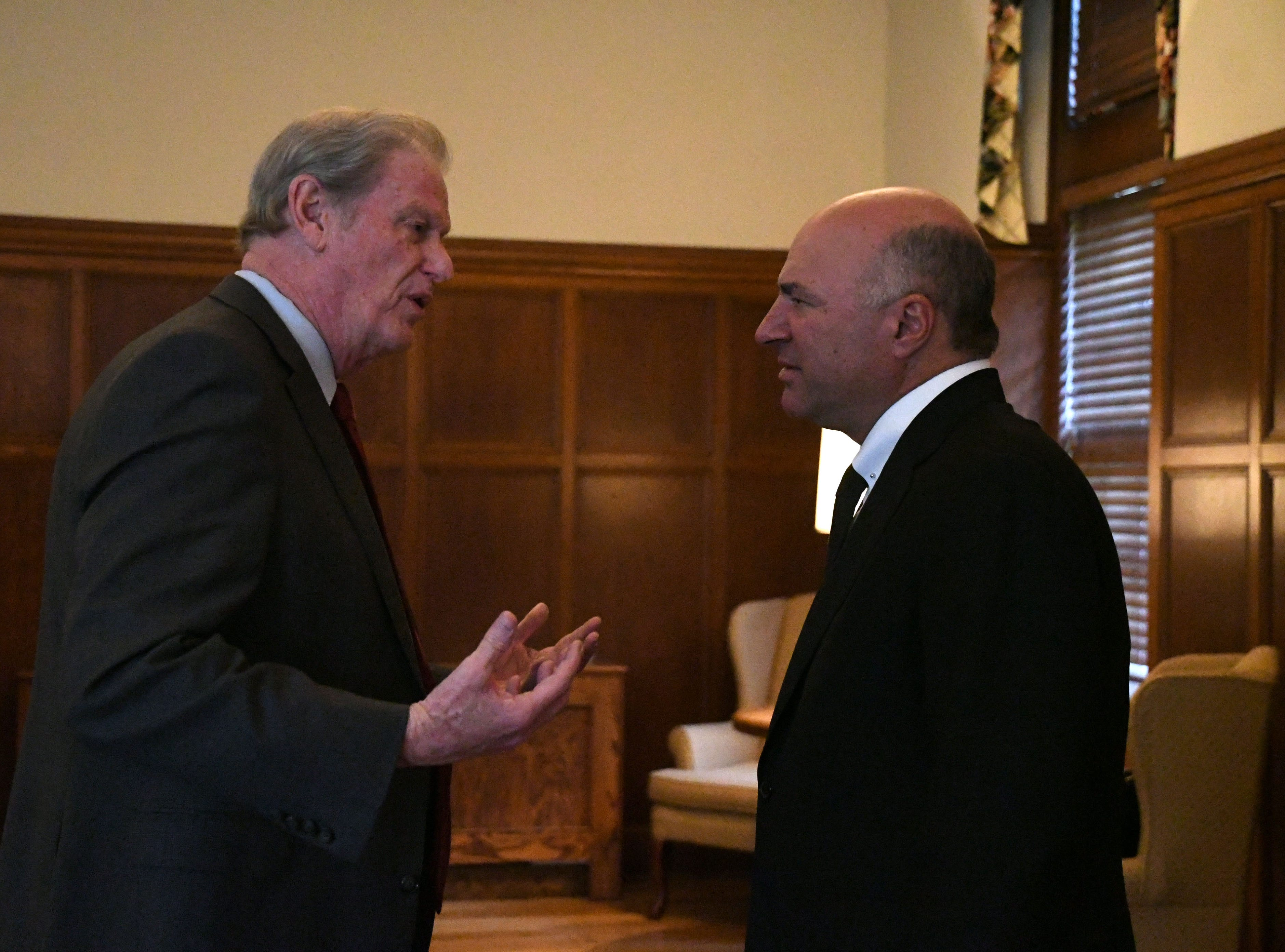 Florida State University President John Thrasher, left, speaks with serial entrepreneur and Shark Tank co-star Kevin O'Leary before O'Leary speaks at the Power Forward business event at Ruby Diamond Hall, Wednesday Feb. 6, 2019.