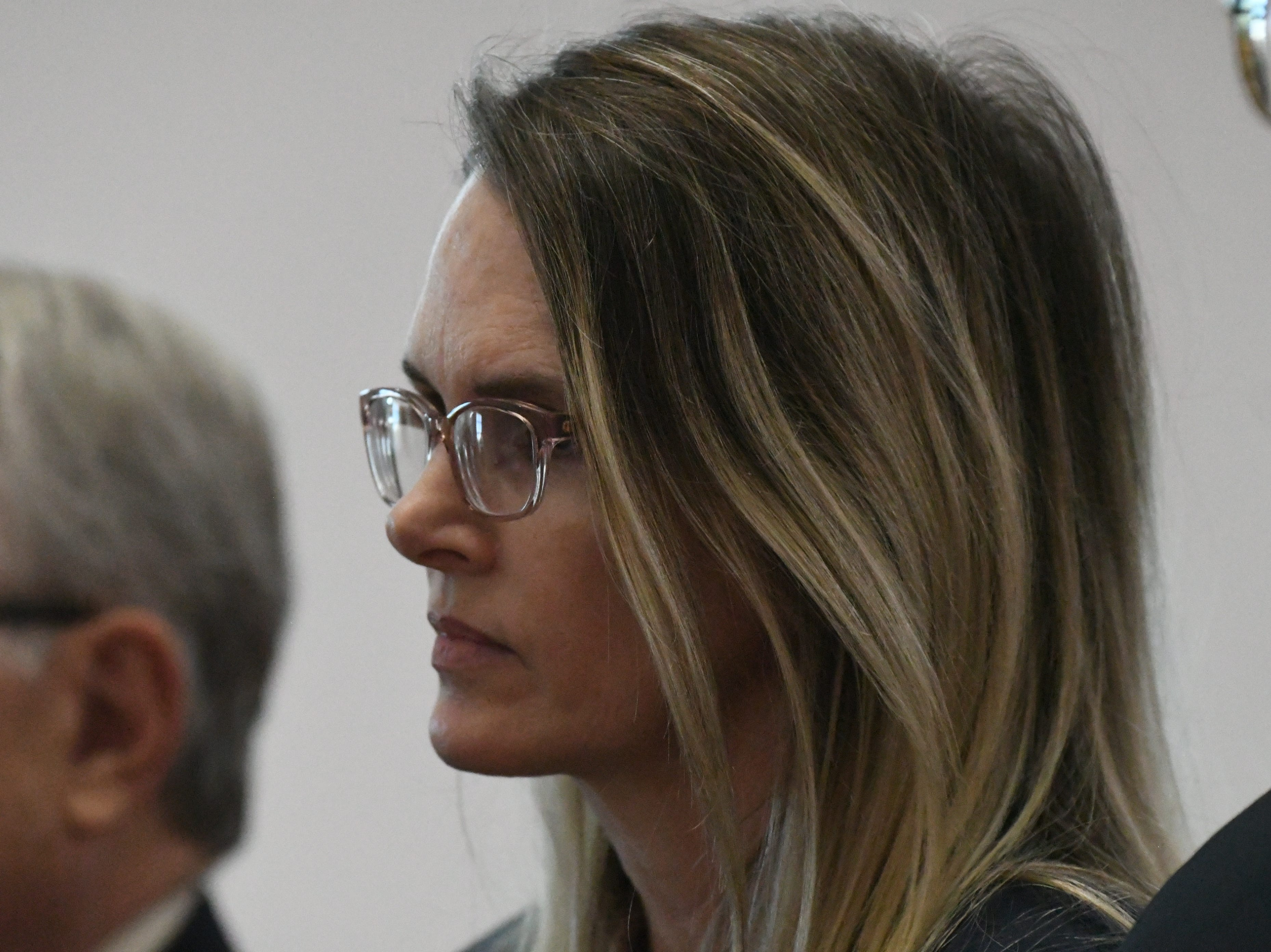 Denise Williams stand between her defense attorneys before Judge James C. Hankinson as she is sentenced for the murder of her husband Mike Williams. Williams was sentenced to life in prison plus 30 years, Wednesday Feb. 6, 2019.