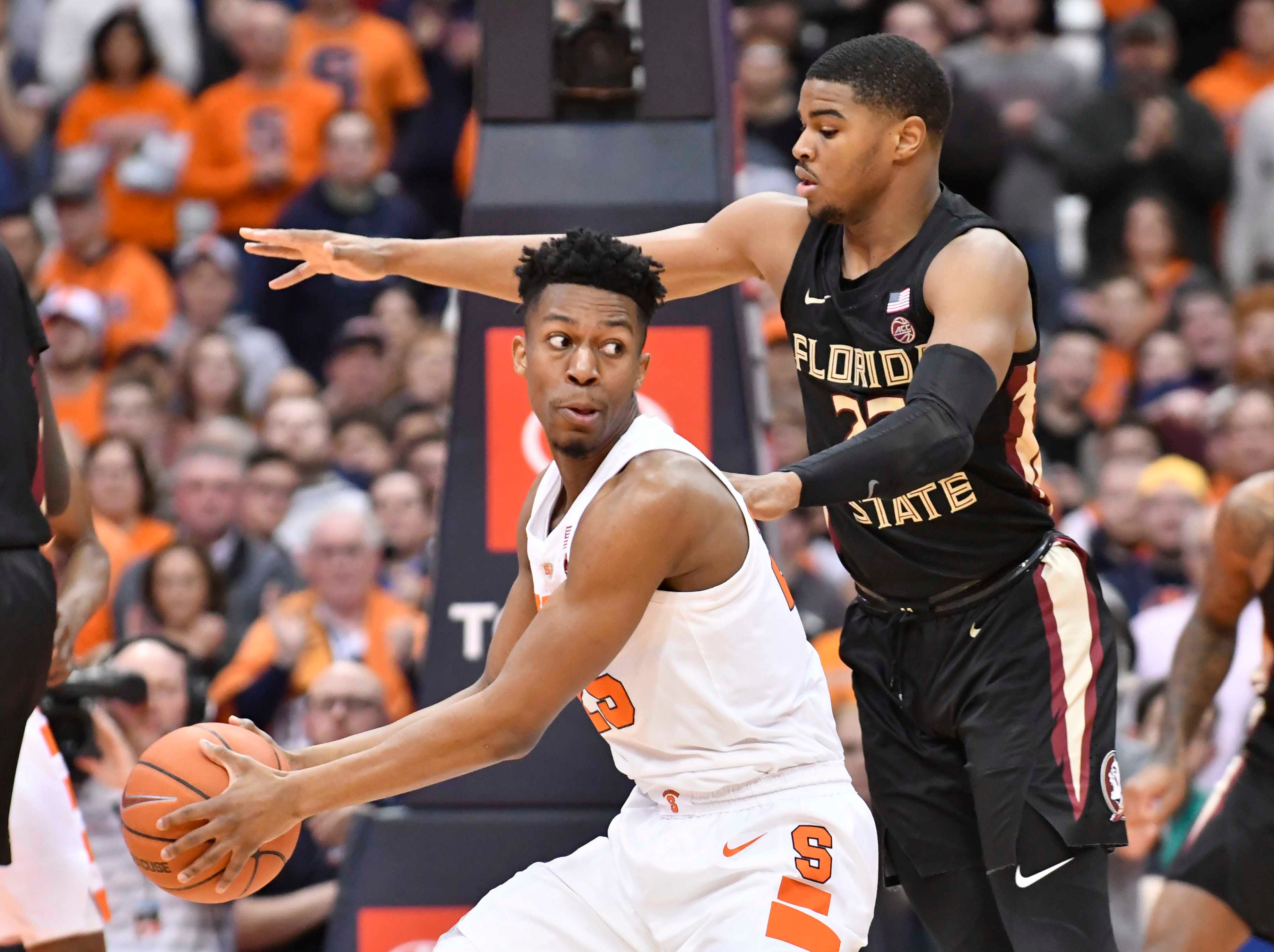 Feb 5, 2019; Syracuse, NY, USA; Syracuse Orange guard Tyus Battle (25) looks to pass the ball as Florida State Seminoles guard M.J. Walker (23) defends in the first half at the Carrier Dome. Mandatory Credit: Mark Konezny-USA TODAY Sports