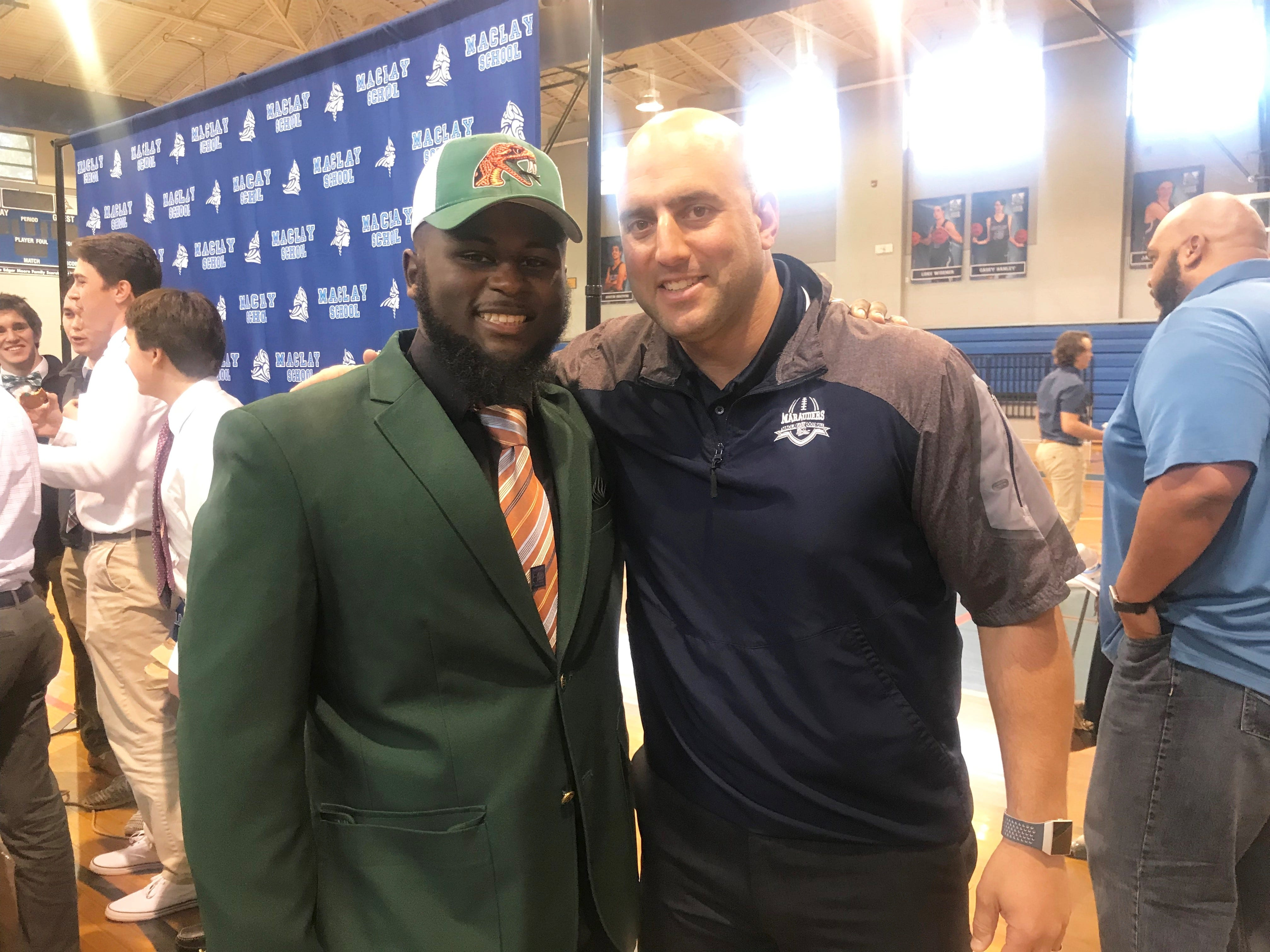 Maclay's Eljin Rhymes poses with head coach Lance Ramer after signing as a preferred walk-on at FAMU during a National Signing Day event on Feb. 6, 2019.
