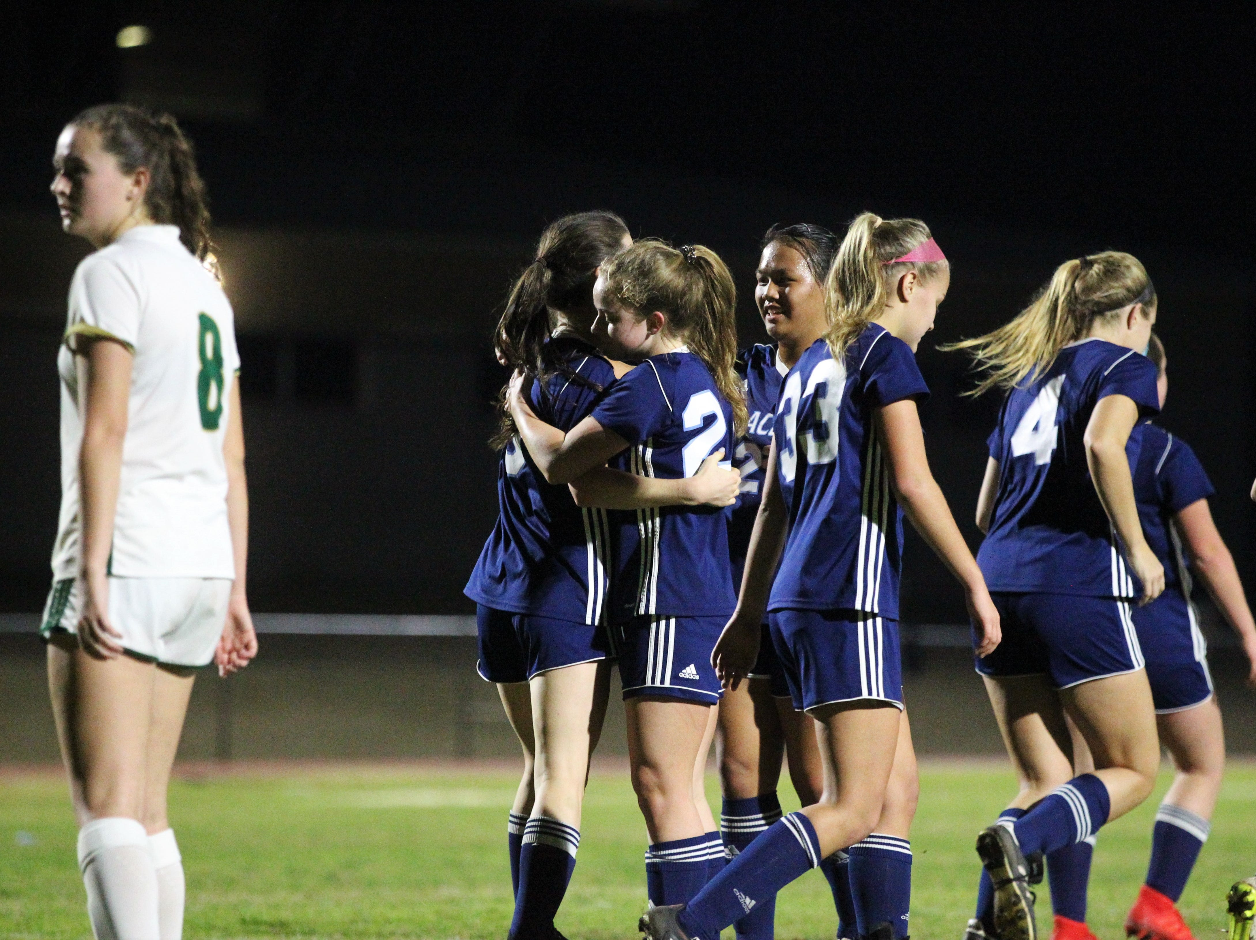 Maclay's Katie Lynch is hugged by teammates after scoring a goal as Maclay's girls soccer team beat St. Joseph Academy 4-0 in a Region 1-1A quarterfinal on Jan. 5, 2019.