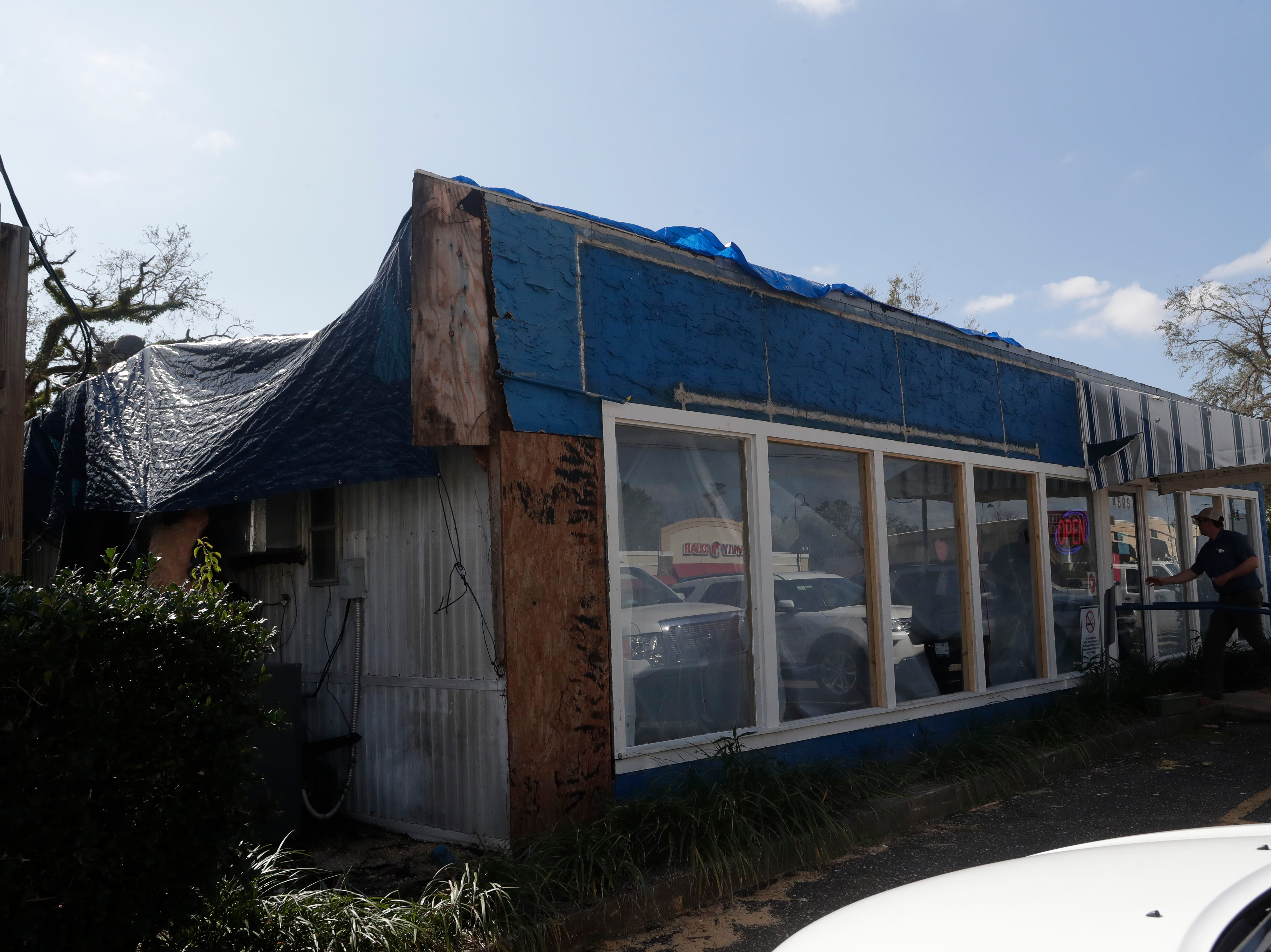 The Waffle Iron in Marianna, Fla. is open for business, Tuesday, Feb. 5, 2019. The restaurant was badly damaged by Hurricane Michael in Oct. 2018 and is still in need of a new roof.