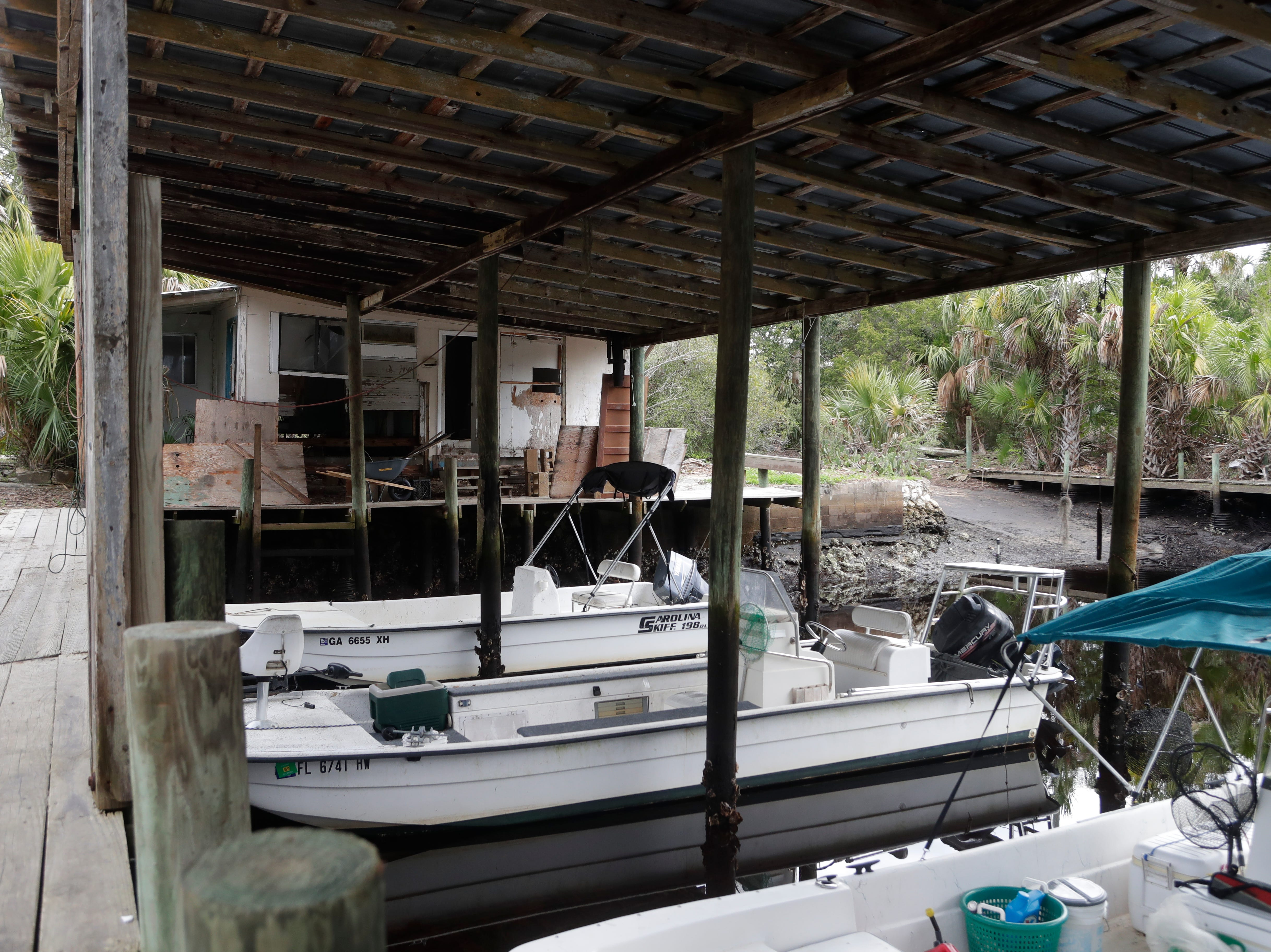 Boats float at the dock of the Spring Creek marina, Tuesday Feb. 5, 2019. The boathouse was torn apart by Hurricane Michael on Oct. 10, 2018.