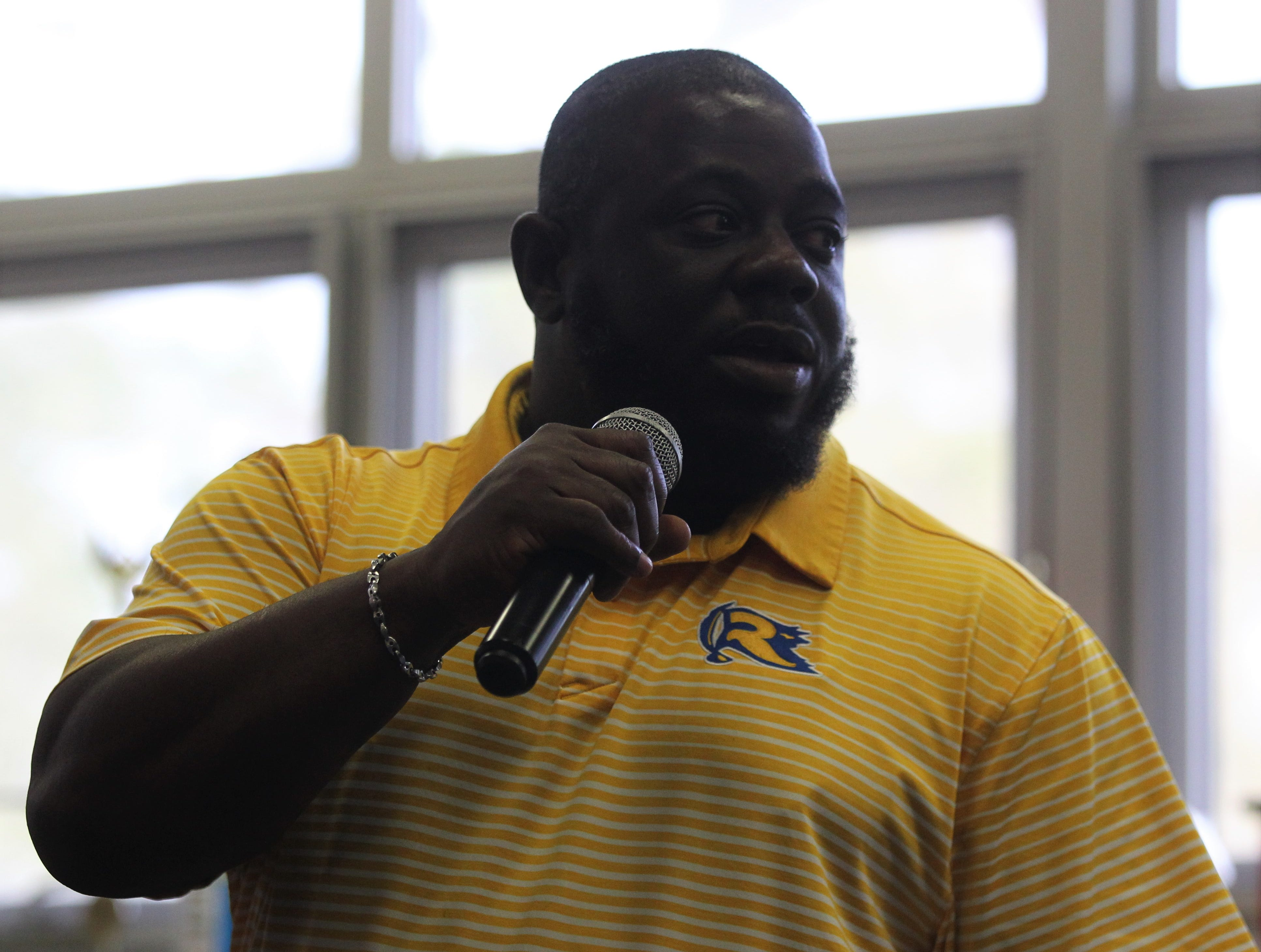 Rickards assistant coach Devin Rispress talks during signing ceremonies on National Signing Day, Feb. 6, 2019.