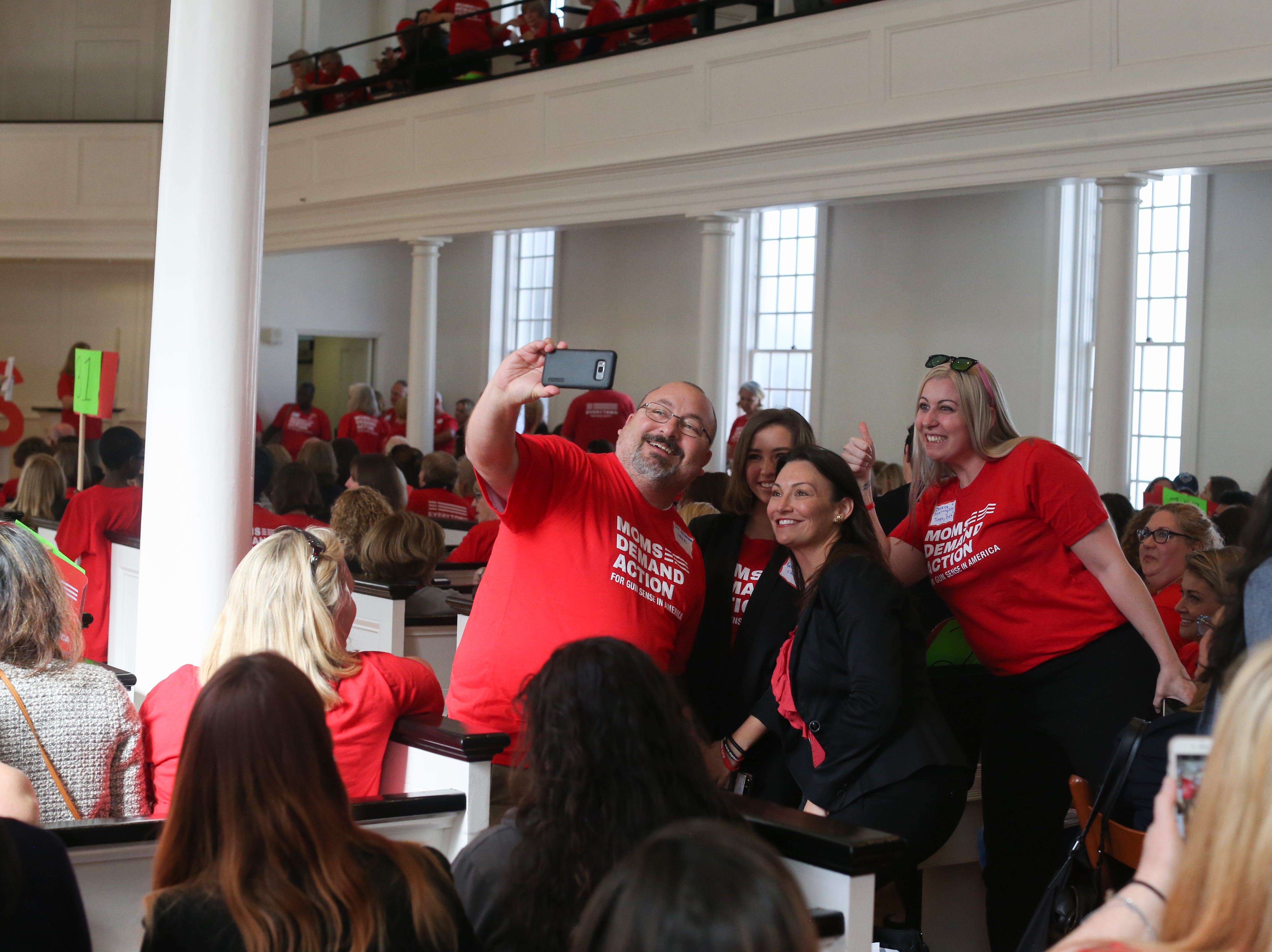 Agriculture Commissioner Nikki Fried is stopped for a selfie on her way out of First Presbyterian Church after addressing the over 500 members of Moms Demand Action who convened there before meeting with lawmakers at the Capitol to lobby for stricter gun laws Wednesday, Feb. 6, 2019.