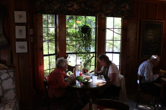 Diners enjoy seafood meal at Spring Creek Restaurant's quaint location in Wakulla County in 2013.