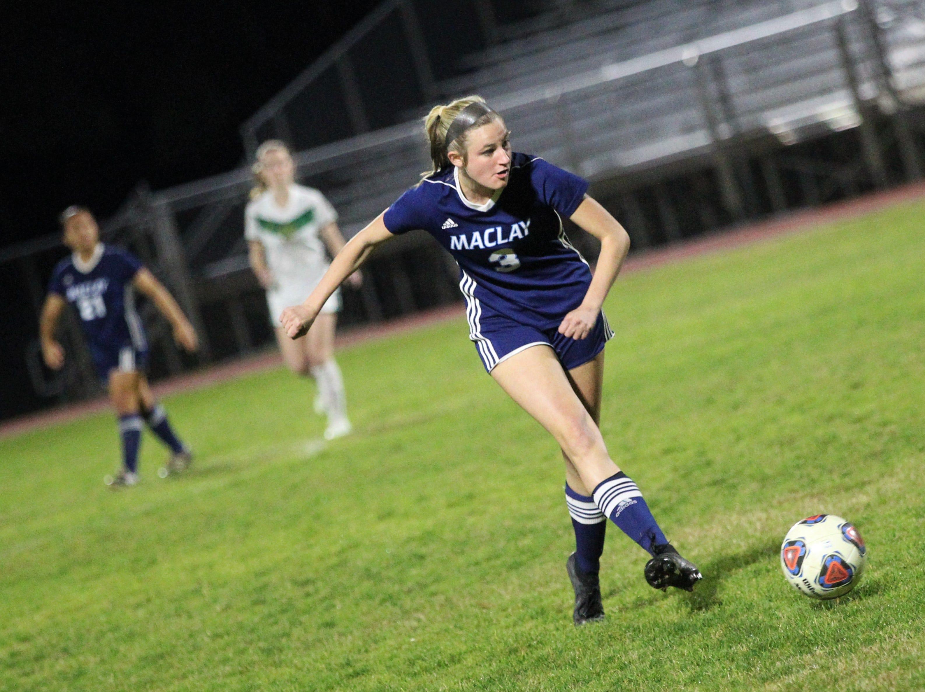 Maclay's Kate Smith plays a pass upfield as Maclay's girls soccer team beat St. Joseph Academy 4-0 in a Region 1-1A quarterfinal on Jan. 5, 2019.