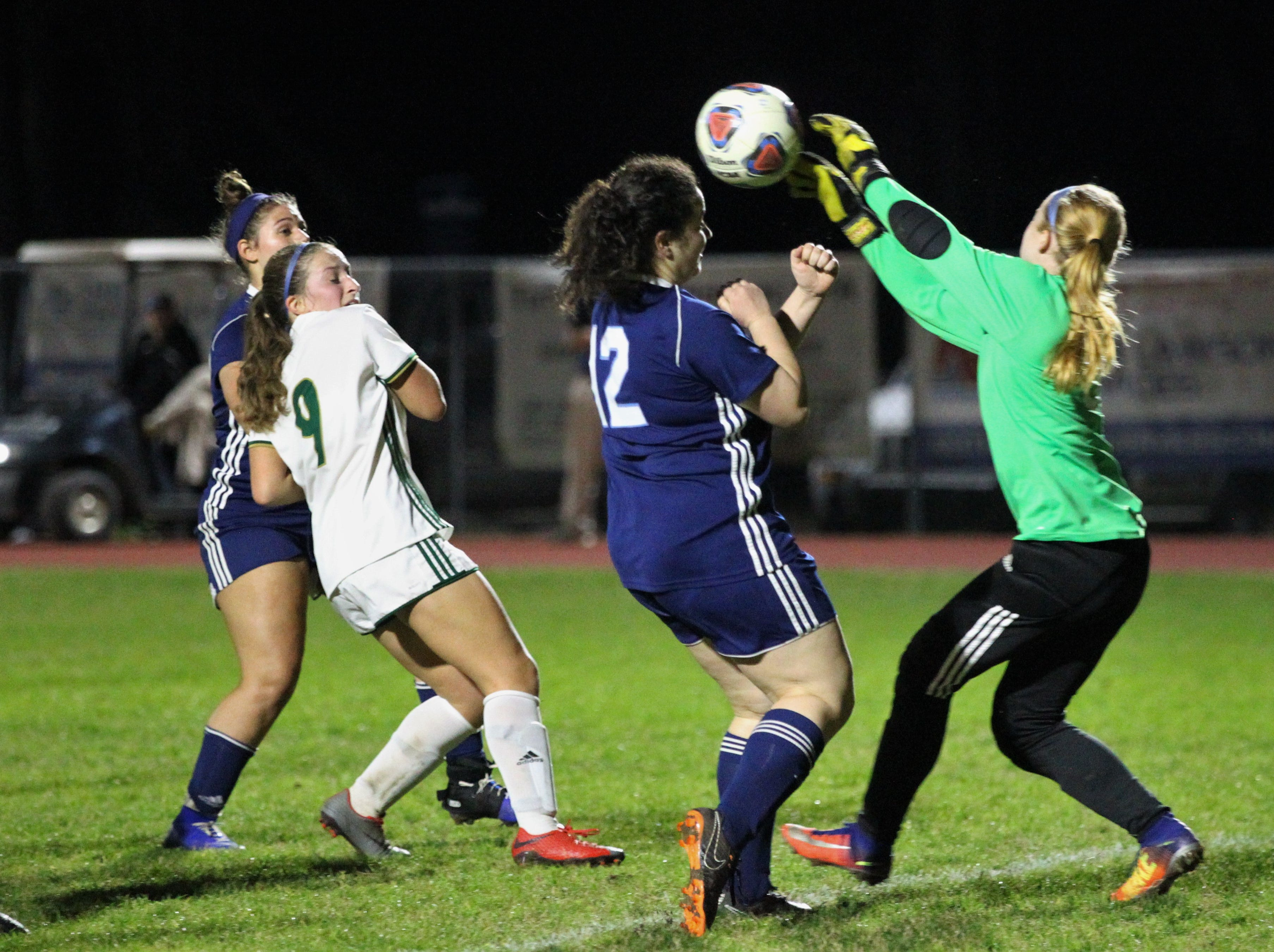 St. Joseph's keeper just gets to a cross before Maclay's Cody Paddack as Maclay's girls soccer team beat St. Joseph Academy 4-0 in a Region 1-1A quarterfinal on Jan. 5, 2019.