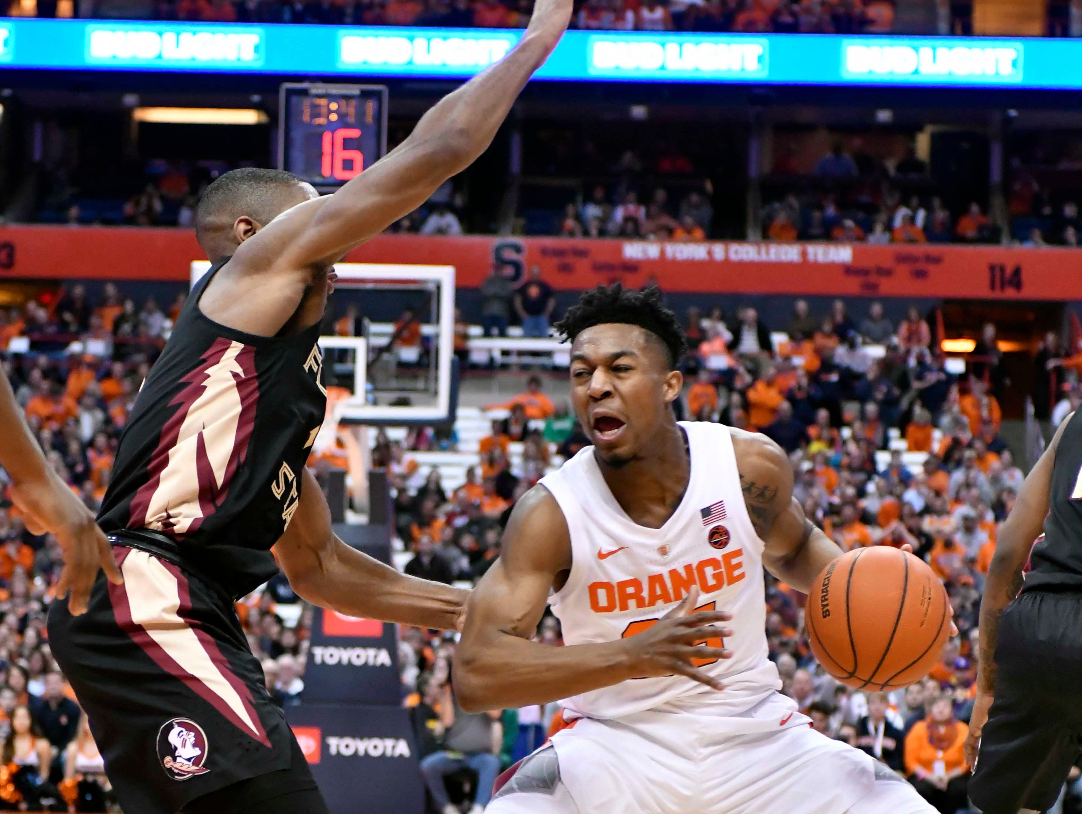 Feb 5, 2019; Syracuse, NY, USA; Syracuse Orange guard Tyus Battle (25) pulls up his dribble as Florida State Seminoles guard Trent Forrest (3) defends in the second half at the Carrier Dome. Mandatory Credit: Mark Konezny-USA TODAY Sports
