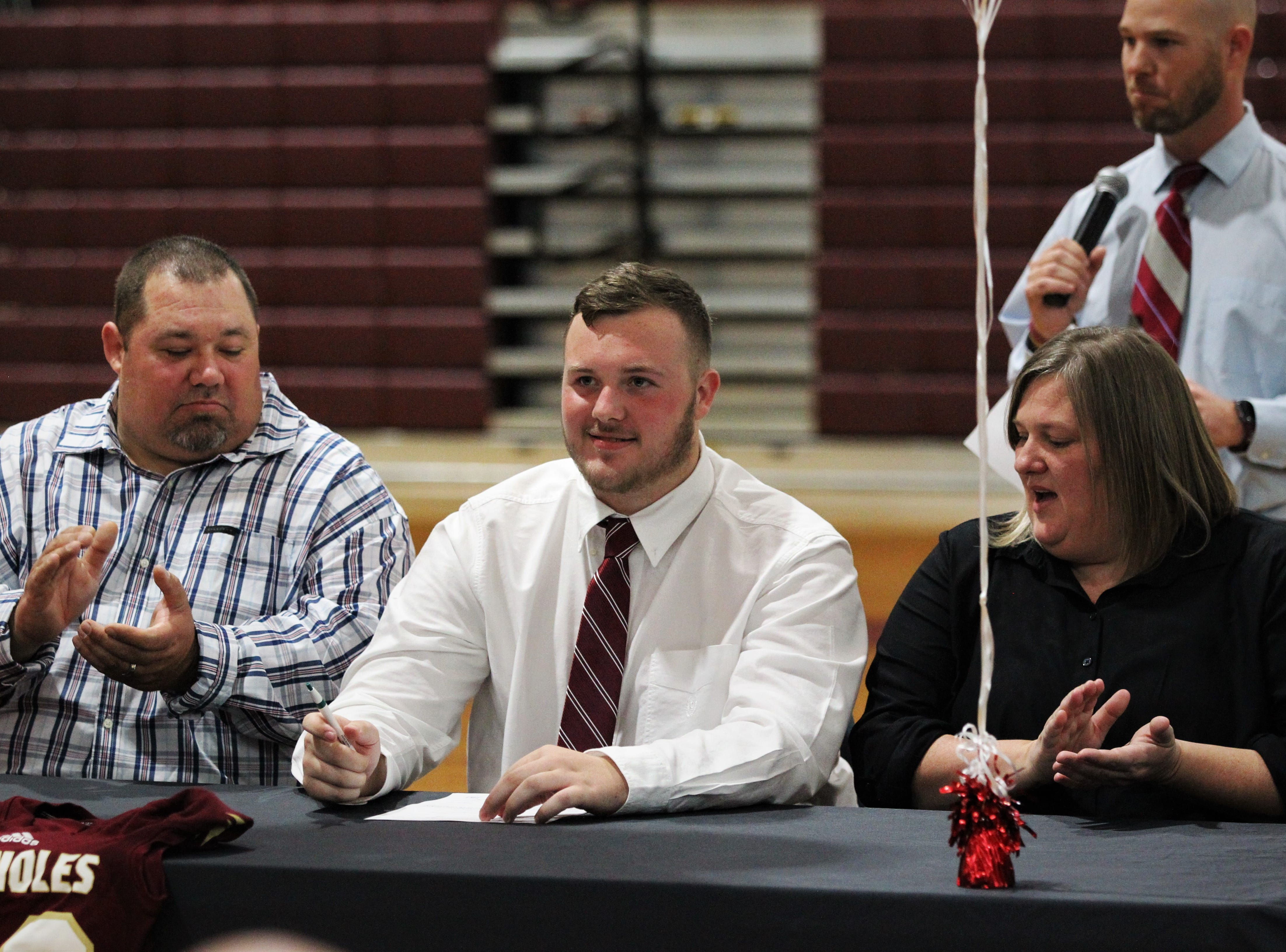 Florida High center Collier Spinosa signed with Fairmont State during signing ceremonies on National Signing Day, Feb. 6, 2019.