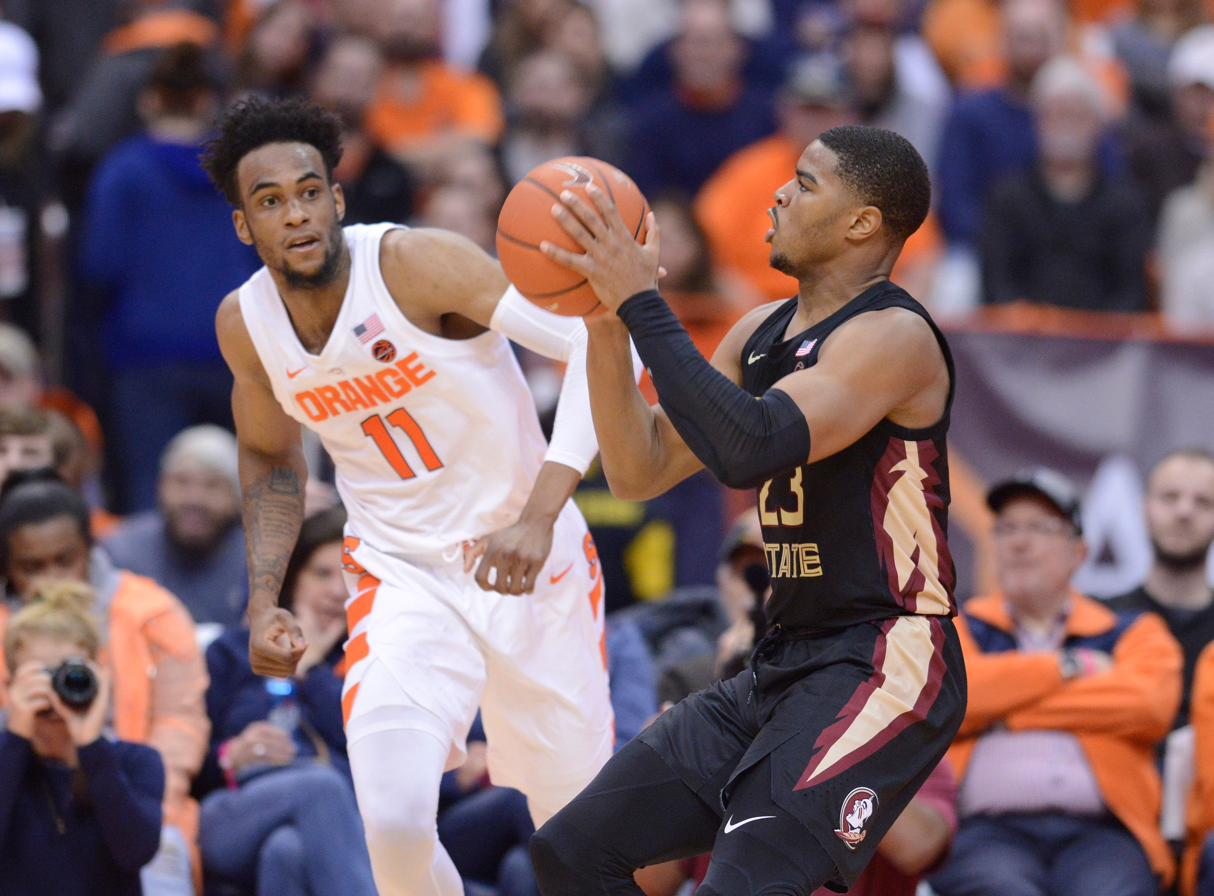 Feb 5, 2019; Syracuse, NY, USA; Florida State Seminoles guard M.J. Walker (23) shoots the ball as Syracuse Orange forward Oshae Brissett (11) defends in the second half at the Carrier Dome. Mandatory Credit: Mark Konezny-USA TODAY Sports