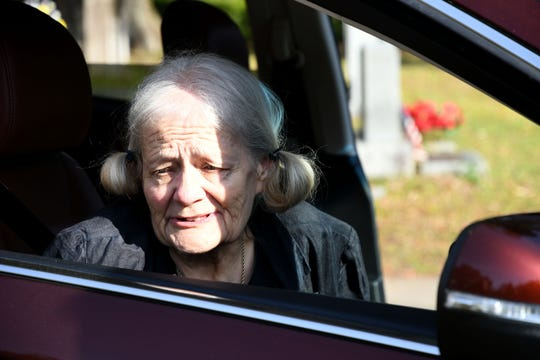 Cheryl Williams, mother of Mike Williams, the man who was murdered over 18 years ago, looks out from the car window at her son's tombstone and gravesite, Wednesday Feb. 6, 2019. Denise Williams, wife of Mike Williams, was sentenced to life in prison plus 30 years.
