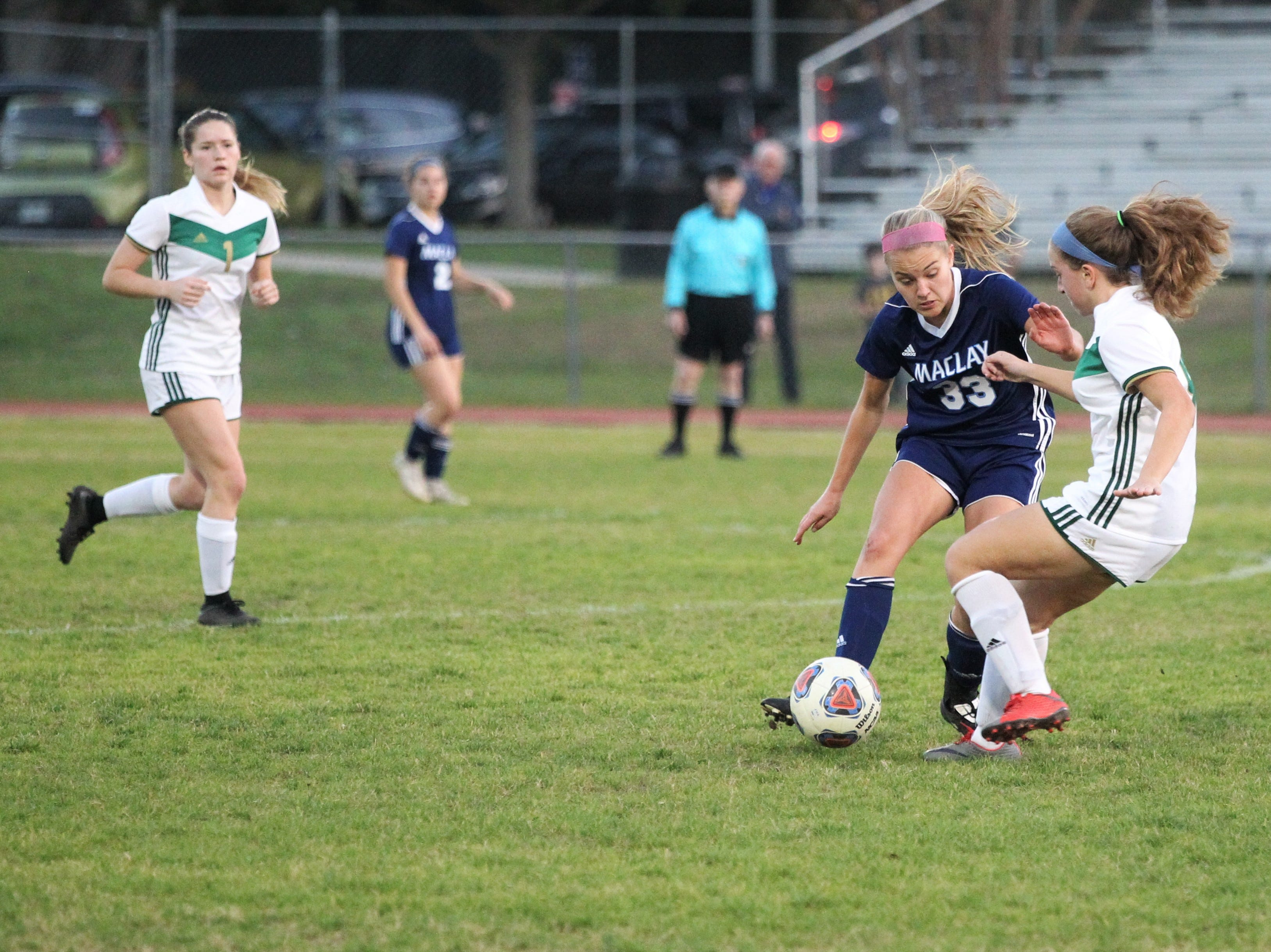 Maclay's Colleen Donahue prepares for a collision as Maclay's girls soccer team beat St. Joseph Academy 4-0 in a Region 1-1A quarterfinal on Jan. 5, 2019.